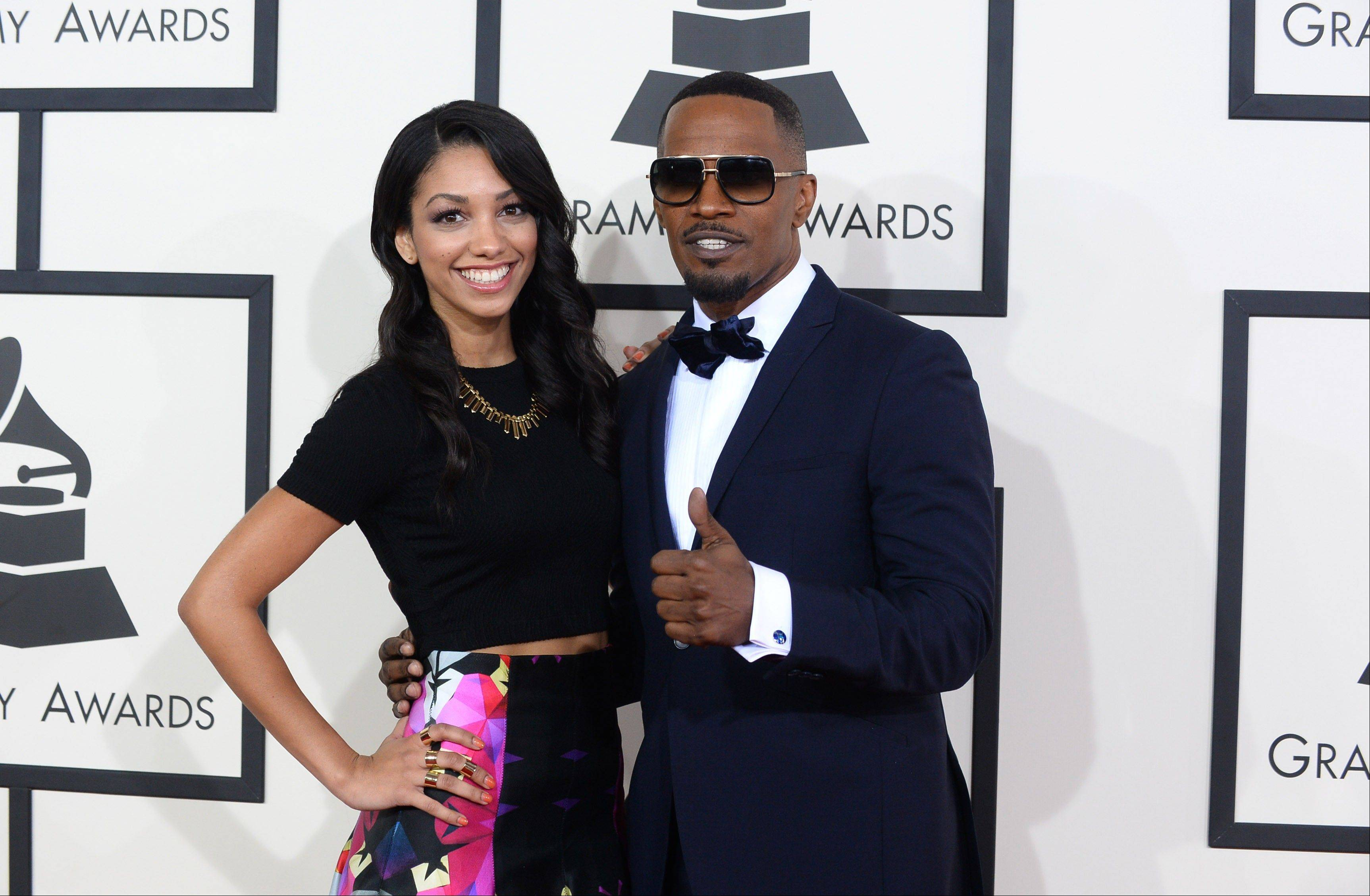 Corinne Bishop and Jamie Foxx arrive at the 56th annual Grammy Awards.