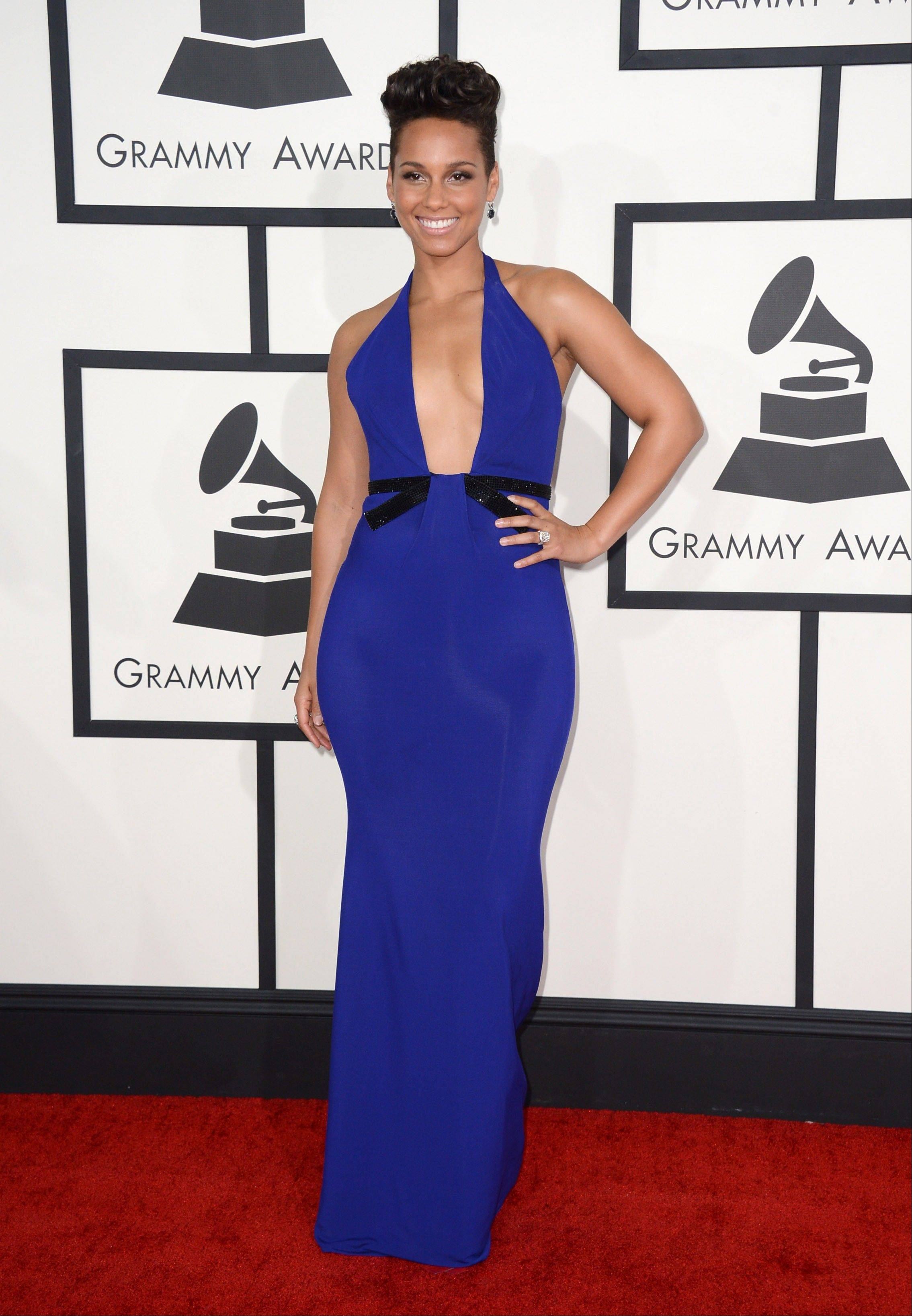 Alicia Keys arrives at the 56th annual Grammy Awards.