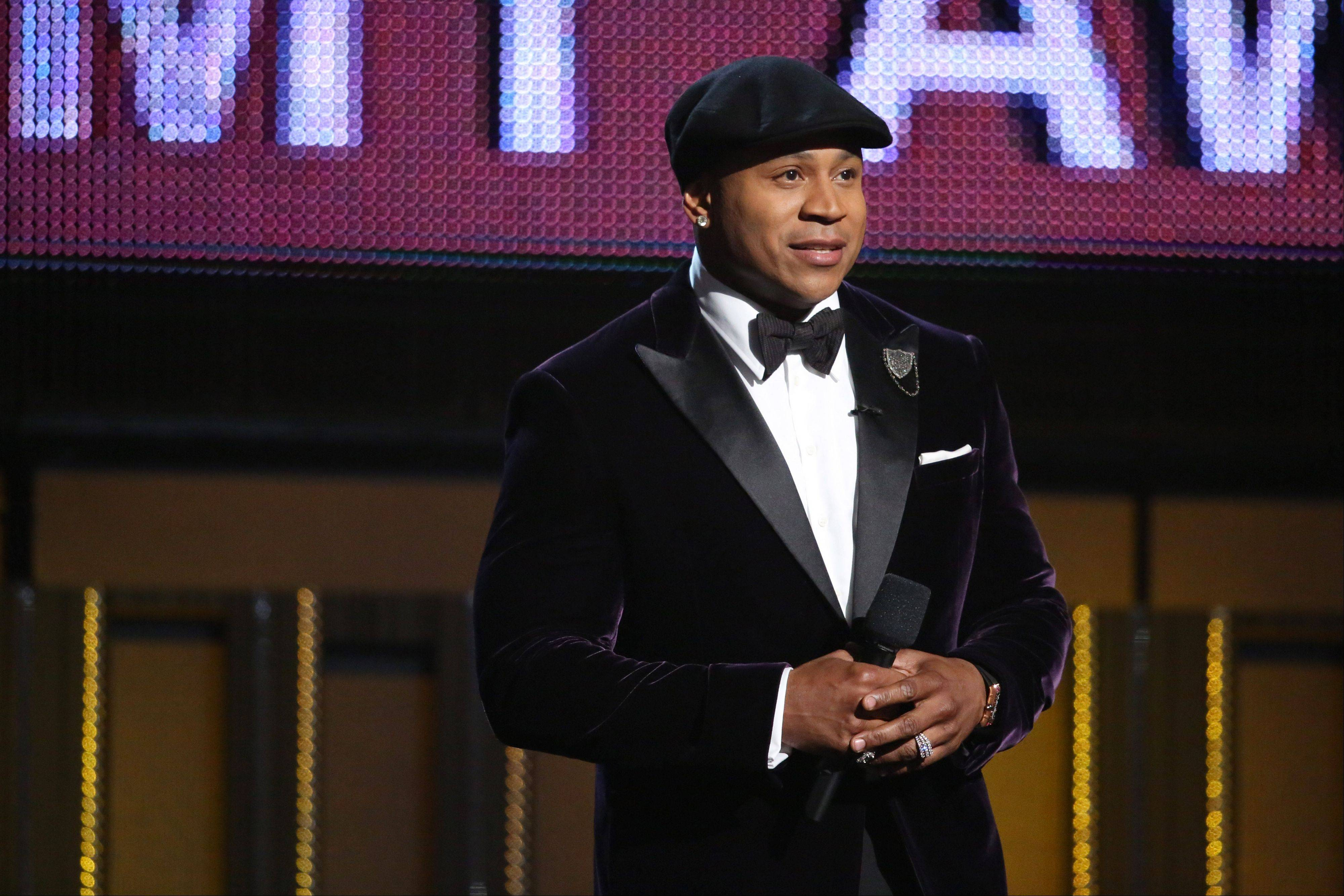 Host LL Cool J speaks on stage at the 56th annual Grammys Awards.