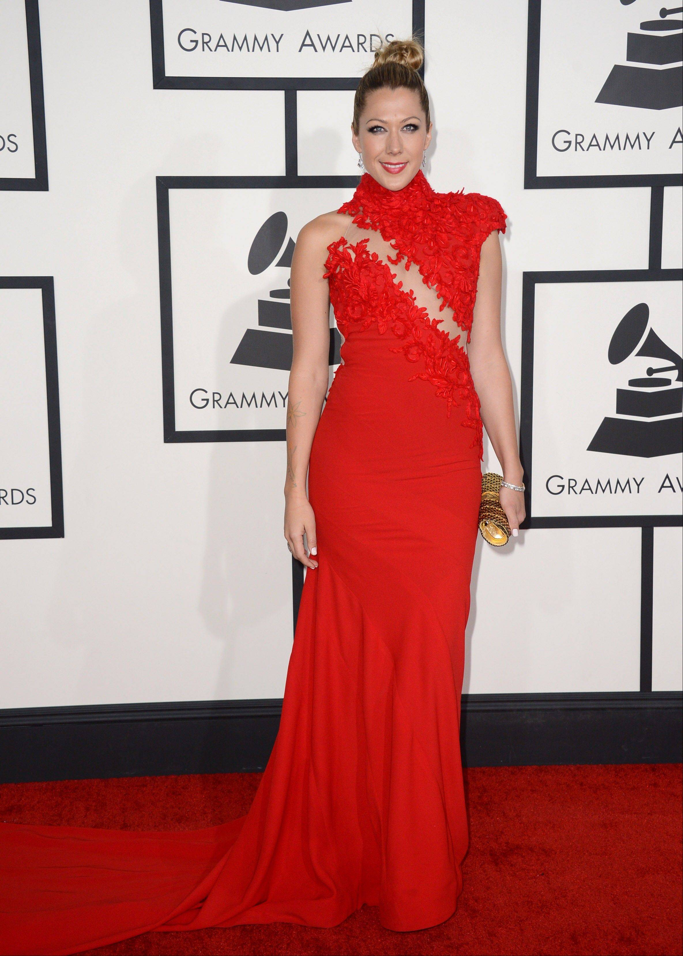 Singer-songwriter Colbie Caillat arrives at the 56th annual Grammy Awards at Staples Center on Sunday in Los Angeles.