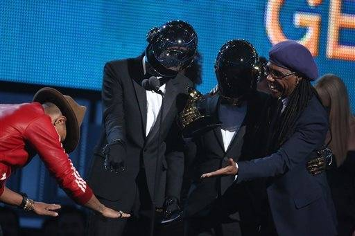 "Pharrell Williams, left, presents the award to Thomas Bangalter, second from left, and Guy-Manuel de Homem-Christo of Daft Punk, and Nile Rodgers for best pop duo/group performance for ""Get Lucky."""