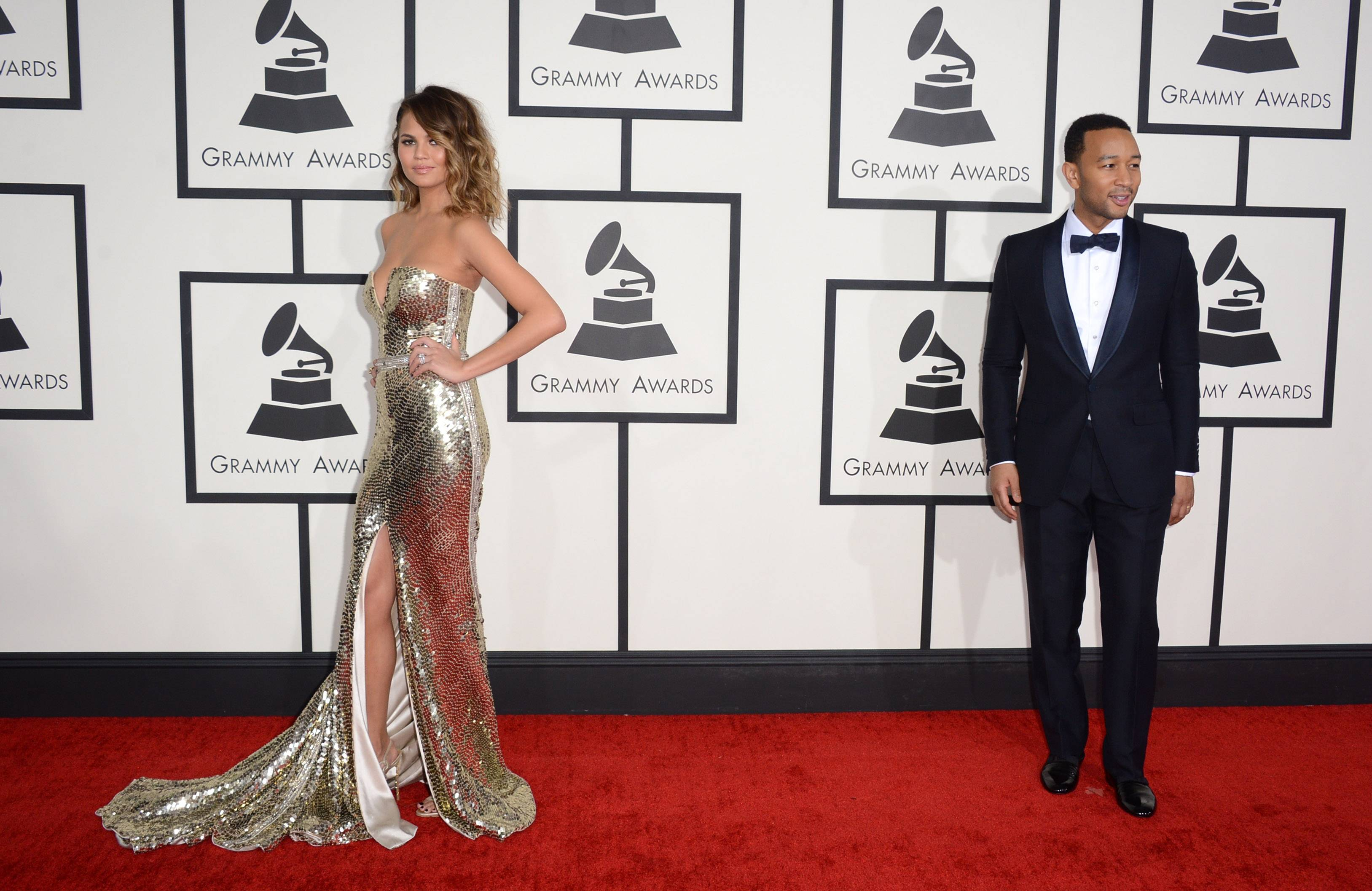 Christine Teigen, left, and John Legend arrive at the 56th annual Grammy Awards.
