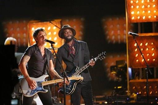 "Keith Urban, left, and Gary Clark, Jr. perform ""Cop Car"" at the 56th annual Grammy Awards"
