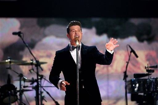 Robin Thicke performs a medleyat the 56th annual Grammy Awards.