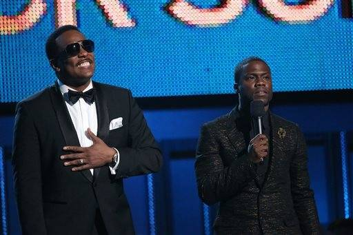 Charlie Wilson, left, and Kevin Hart present the award for best rock song at the 56th annual Grammy Awards at Staples Center on Sunday.
