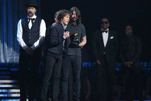 "Krist Novoselic, left, looks on as Paul McCartney, center left, and Dave Grohl, center right, accept the award for best rock song for ""Cut Me Some Slack."