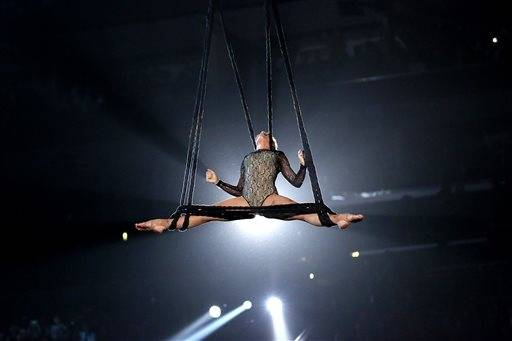 Pink brings her high flying routine from her tour to the Grammys.