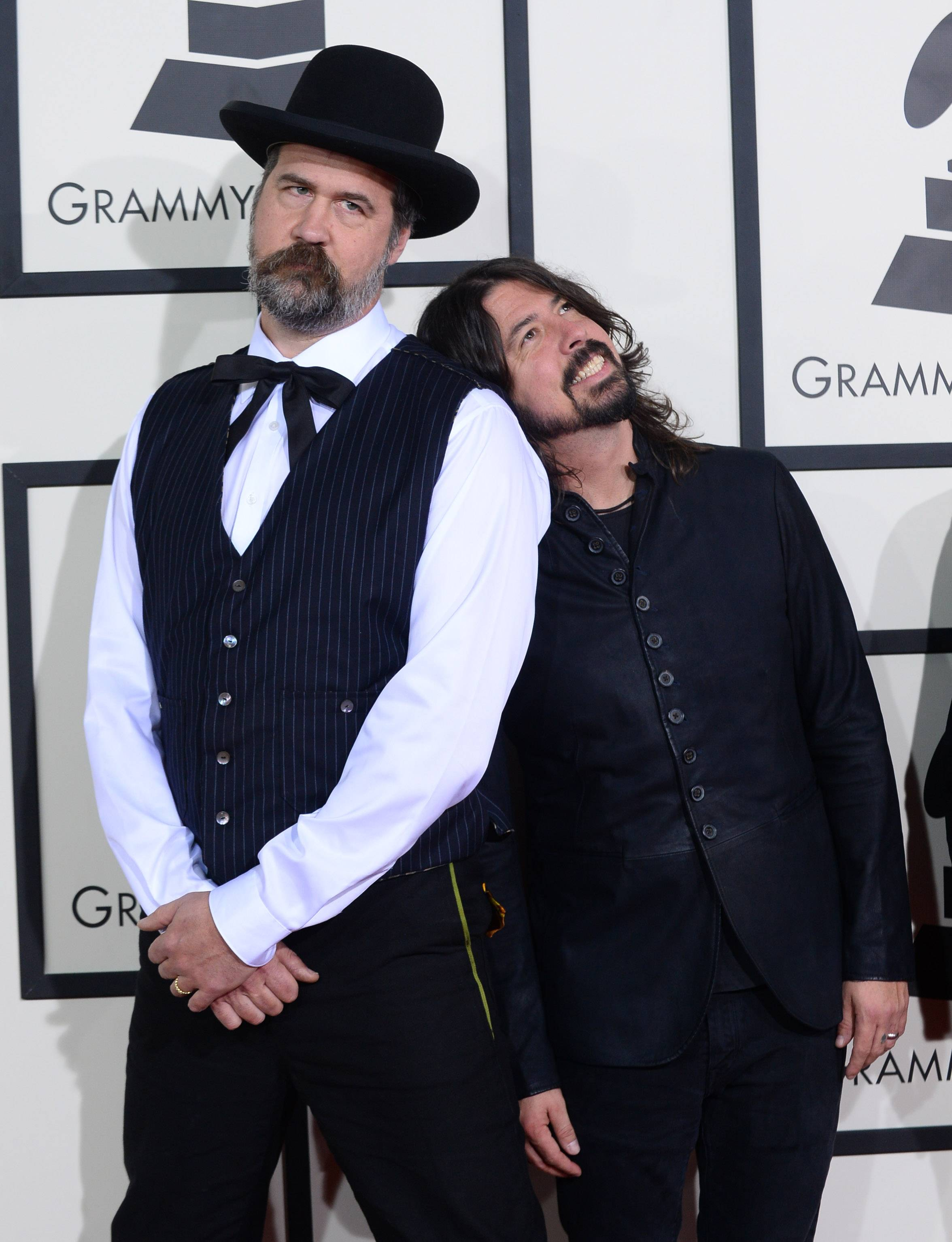 Krist Novoselic, left, and Dave Grohl have a little fun while walking the red carpet at the Grammys.