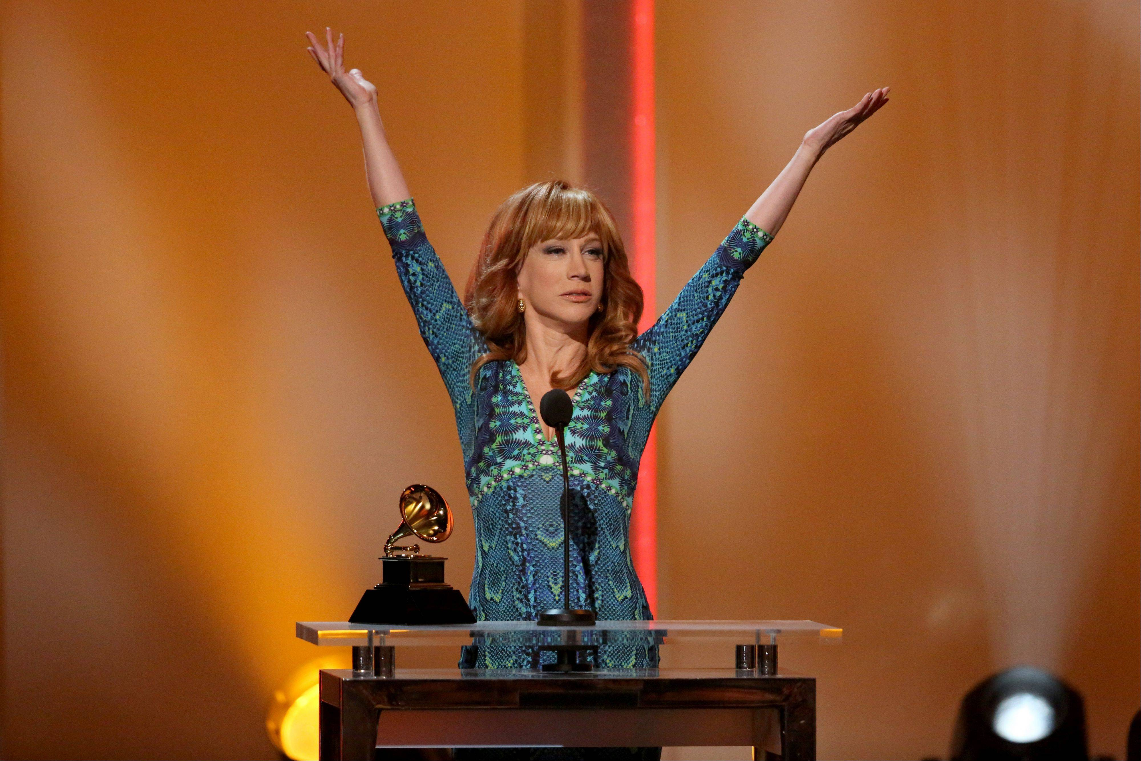 "Kathy Griffin accepts the best comedy album award for ""Calm Down Gurrl"" at the pre-telecast of the 56th annual Grammy Awards on Sunday in Los Angeles. Griffing joked about Justin Bieber in her speech and didn't forget her mom, either. ""I've never made my 93-year-old alcoholic mother more proud,"" she added."