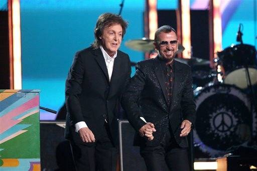 Paul McCartney and Ringo Starr have a little fun after their performance at the Grammys.