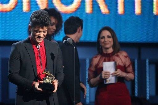 "Bruno Mars accepts the award for best pop vocal album for ""Unorthodox Jukebox."""