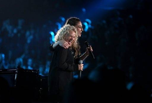 Carole King, left, and Sara Bareilles present the award for song of the year after performing together.