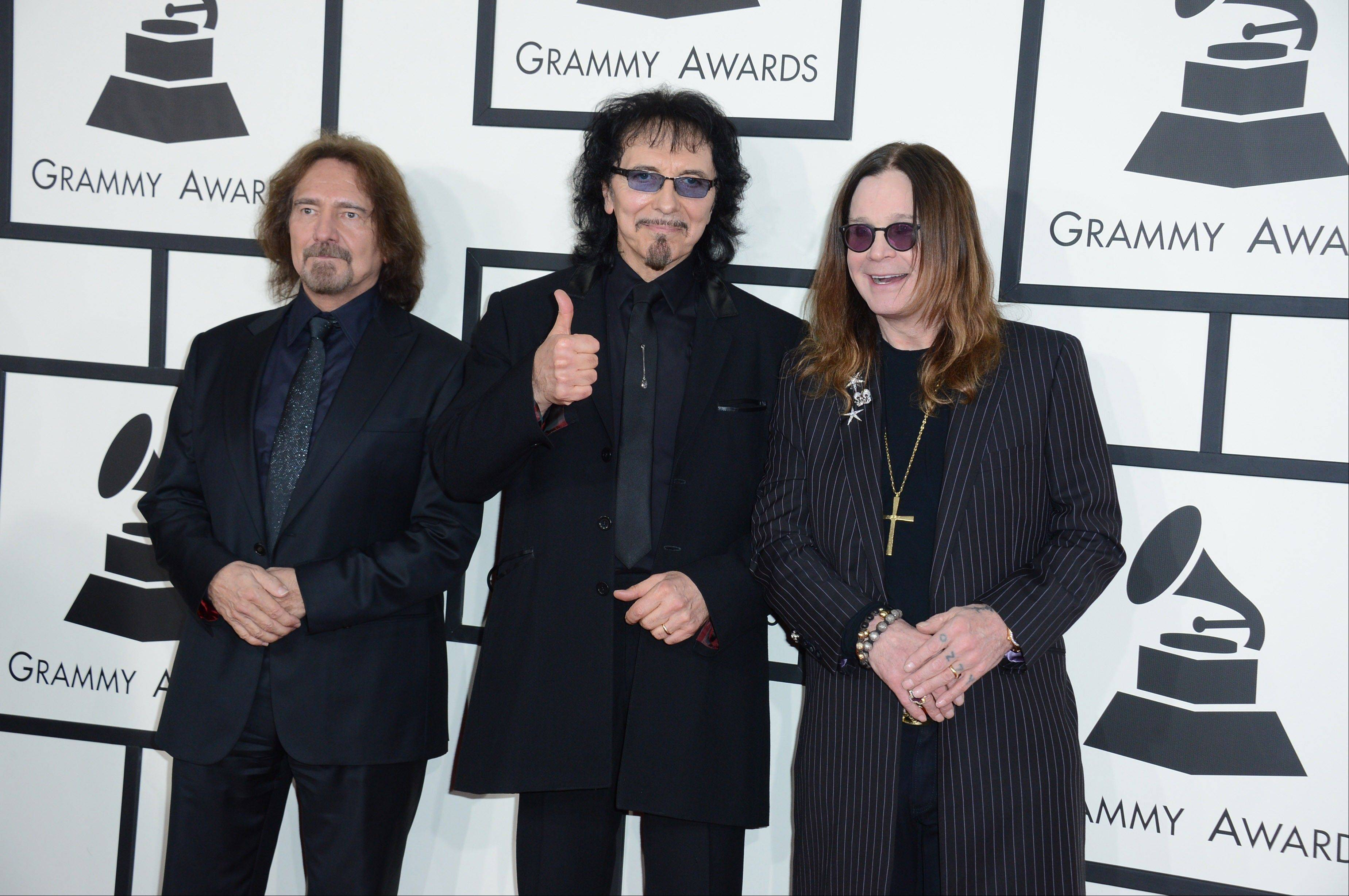 From left, Geezer Butler, Tony Iommi and Ozzy Osbourne of Black Sabbath arrive at the 56th annual Grammy Awards at Staples Center on Sunday in Los Angeles.