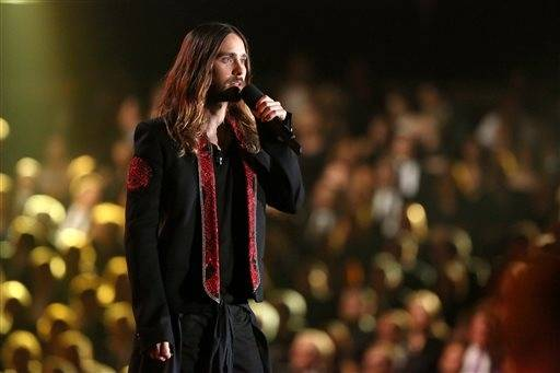 Actor and 30 Seconds to Mars frontman Jared Leto speaks on stage at the 56th annual Grammy Awards.