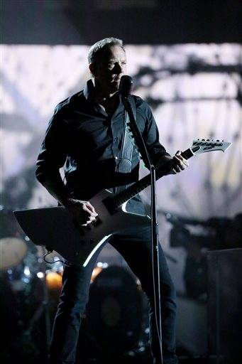 "James Hetfield of Metallica performs ""One"" at the 56th annual Grammy Awards."