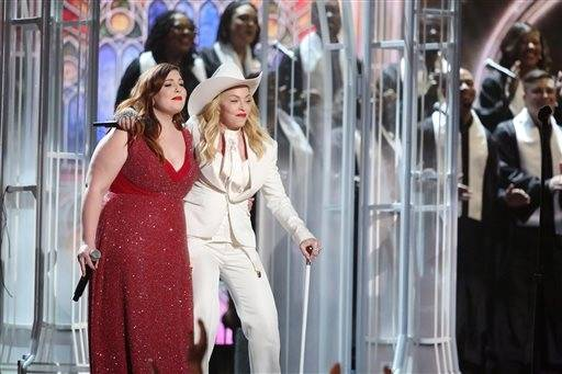"Mary Lambert, left, and Madonna perform ""Same Love"" on stage at the 56th annual Grammy Awards."