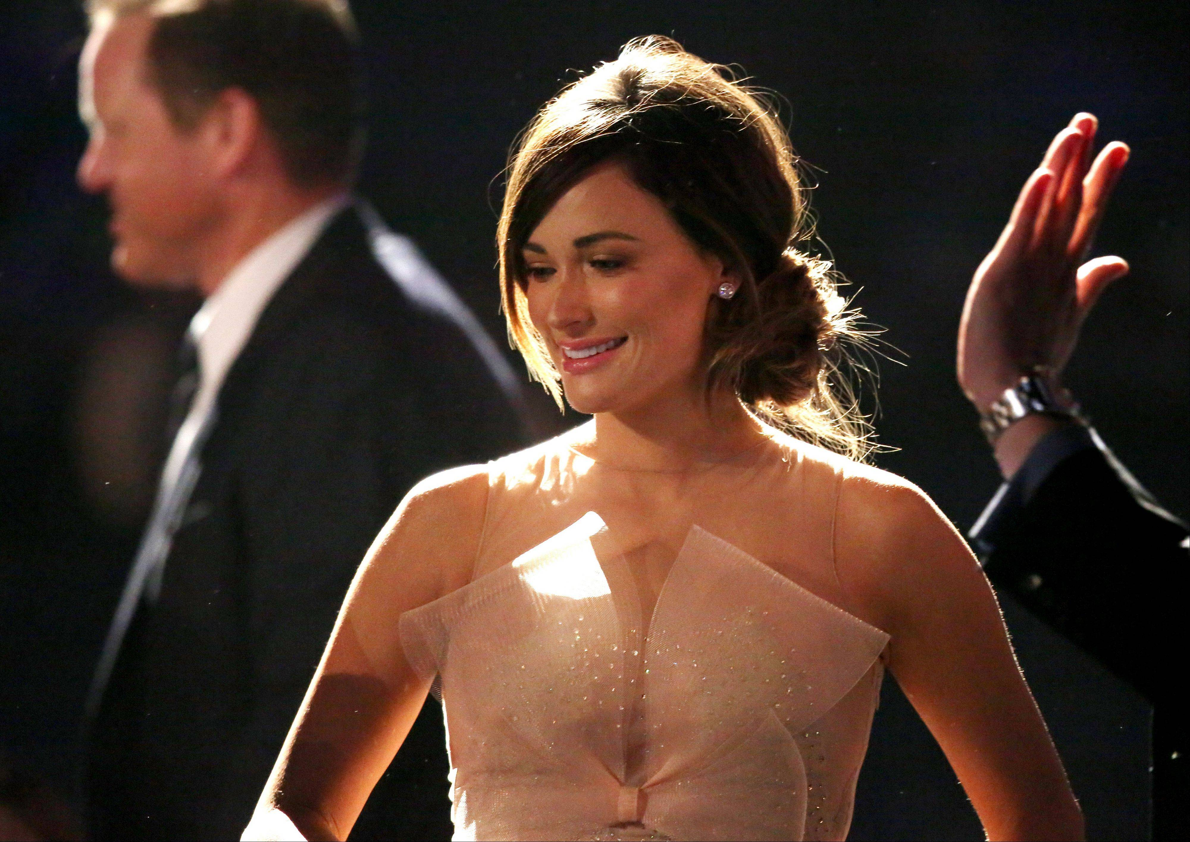 "Kacey Musgraves, winner of the best country song award for ""Merry Go 'Round,"" walks on stage at the pre-telecast of the 56th annual Grammy Awards on Sunday."