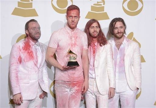 "Members of Imagine Dragons, from left, Ben McKee, Ben Reynolds, Wayne Sermon and Dan Platzman pose in the press room with the award for best rock performance for ""Radioactive."""