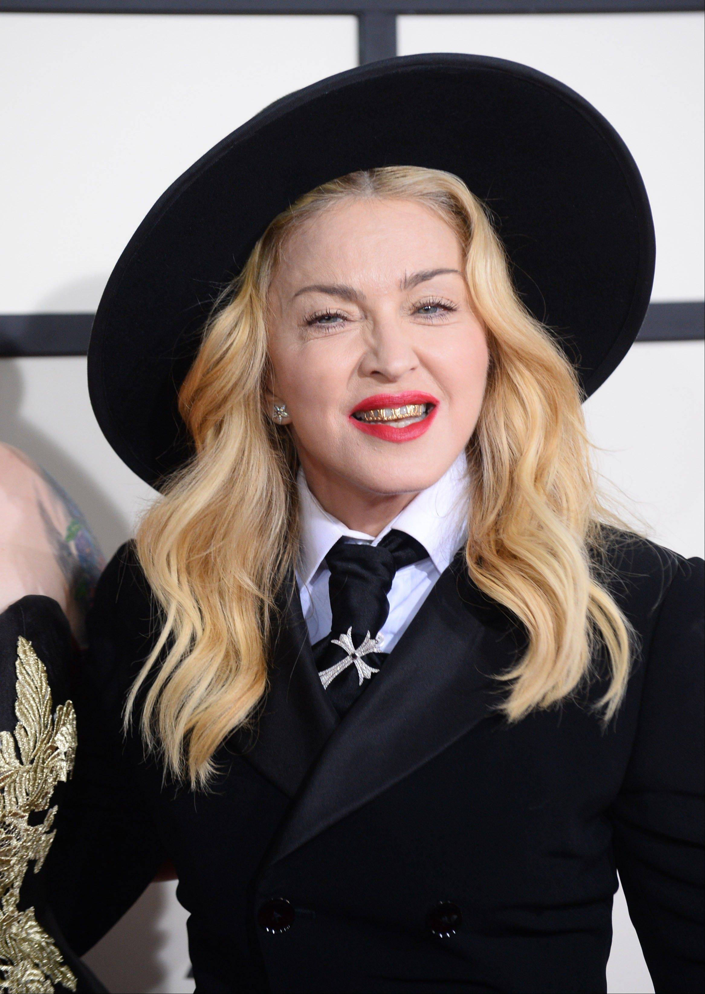 Madonna wears a grill as she arrives at the 56th annual Grammy Awards at Staples Center on Sunday.