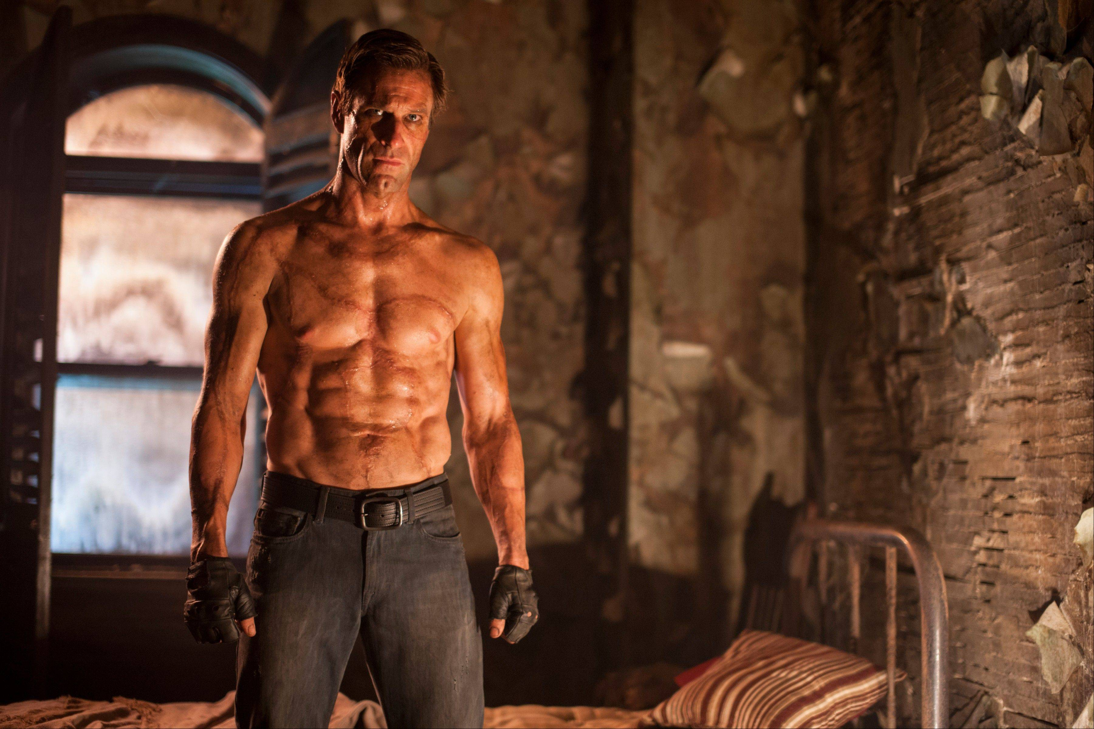 "This image released by Lionsgate shows Aaron Eckhart in a scene from the film, ""I, Frankenstein."" The monster thriller ""I, Frankenstein"" had a dismal debut at the box office coming in sixth in its first weekend of release."