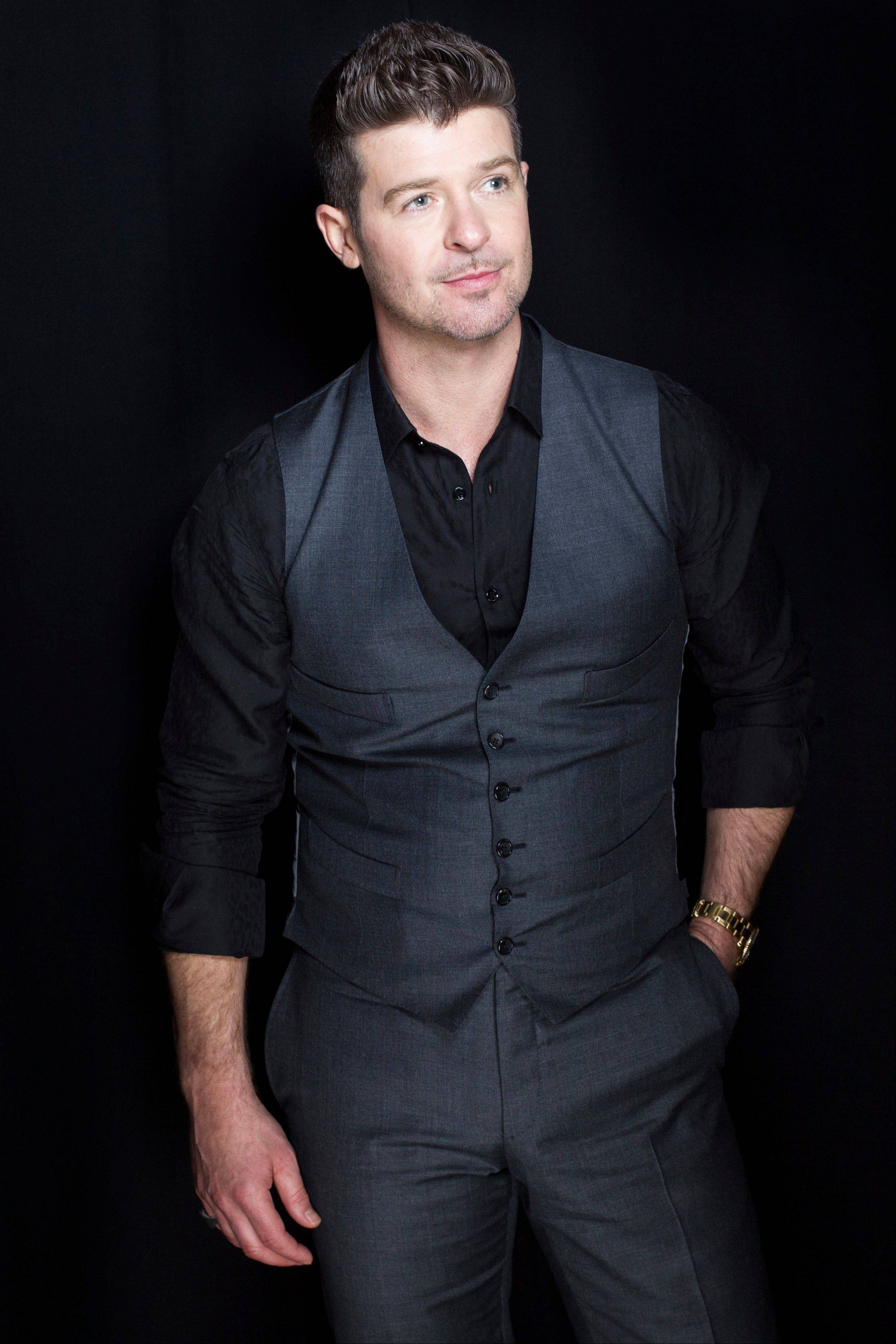 "R&B singer-songwriter Robin Thicke has three Grammy nominations, including record of the year for ""Blurred Lines."""