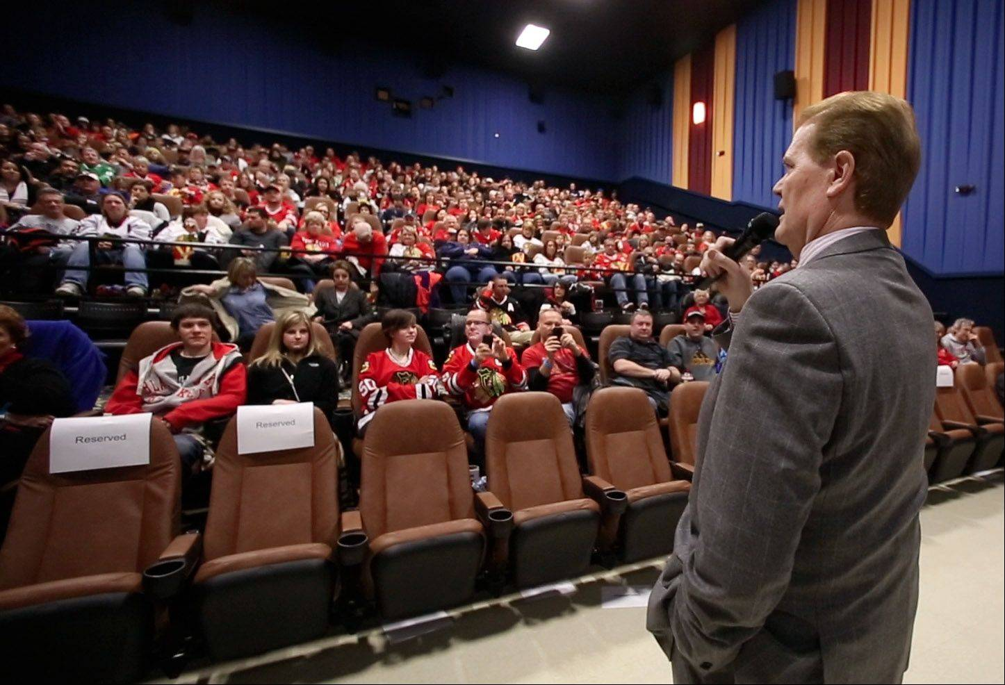 "Broadcaster Chet Coppock introduces Chicago Blackhawks President and CEO John McDonough before a screening of the film ""17 Seconds"" on Sunday at Classic Cinemas Theater in Elk Grove Village. The event, which also included autograph signings and giveaways, was presented by the Daily Herald and the Blackhawks."