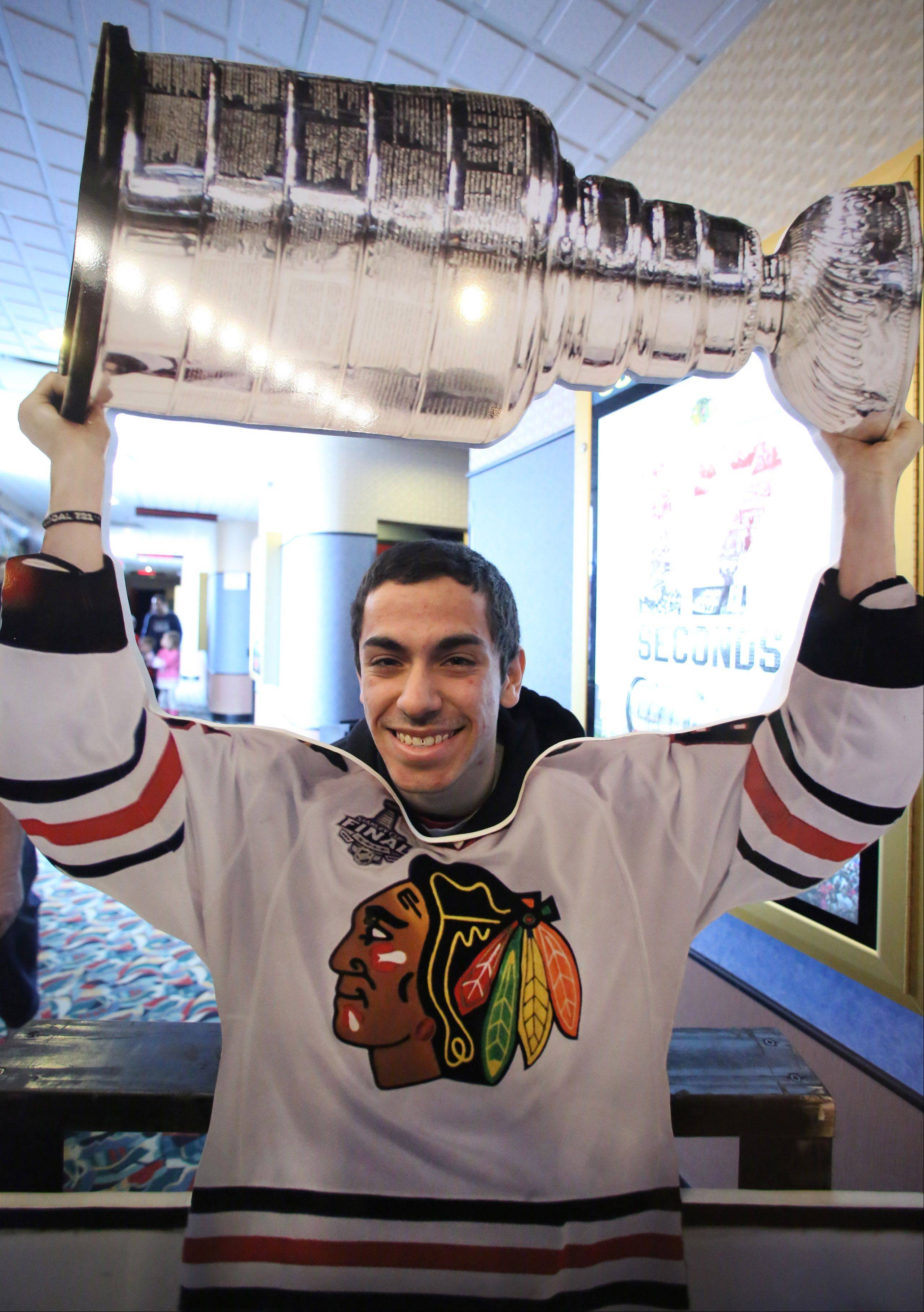 "Dominic Mancini of Mount Prospect poses behind a Blackhawks jersey cutout Sunday before a screening of the film ""17 Seconds"" at Classic Cinemas Theater in Elk Grove Village. The event, which also included autograph signings and giveaways, was presented by the Daily Herald and the Blackhawks."