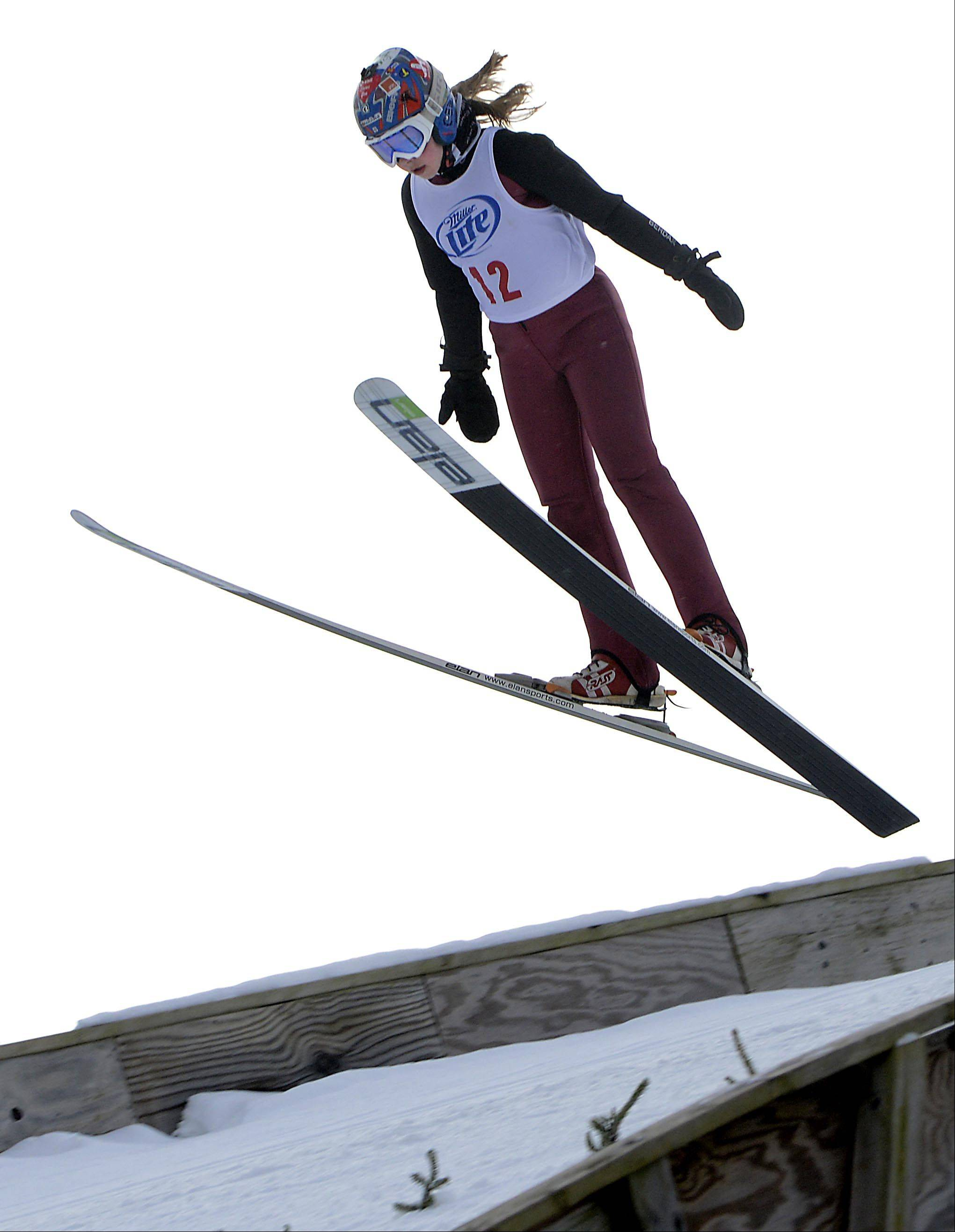 Cara Larson, 13, of Barrington competes in the Under 20 Women's Class, jumps Sunday at the Norge International Ski Jumping Tournament in Fox River Grove. She belongs to the Norge Ski Club and has been jumping for six years.
