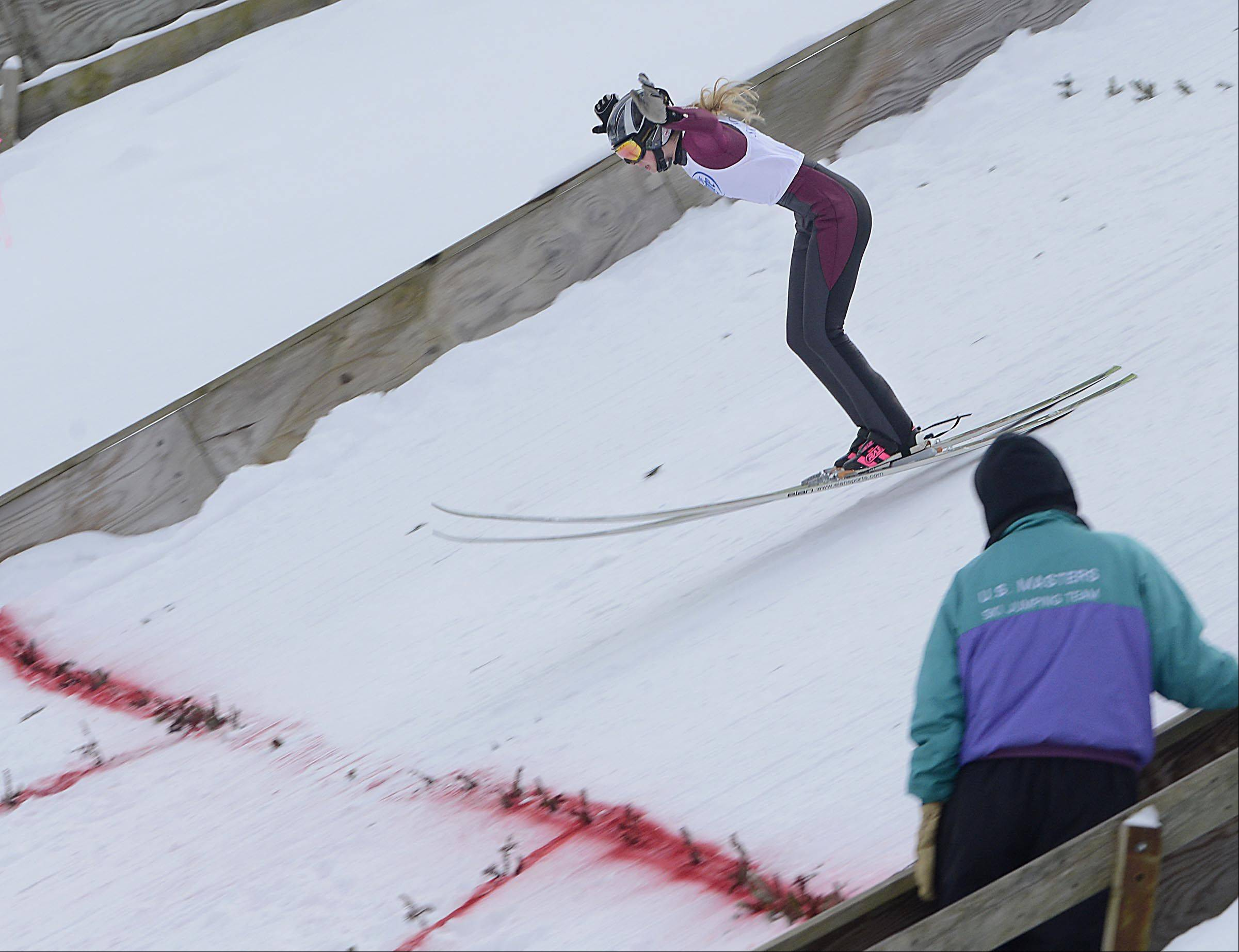 Tara Geaghty-Moats, 20, of New York, touches down on the 70-meter hill Sunday at the Norge International Ski Jumping Tournament in Fox River Grove. More than 60 skiers competed in Sunday's event.