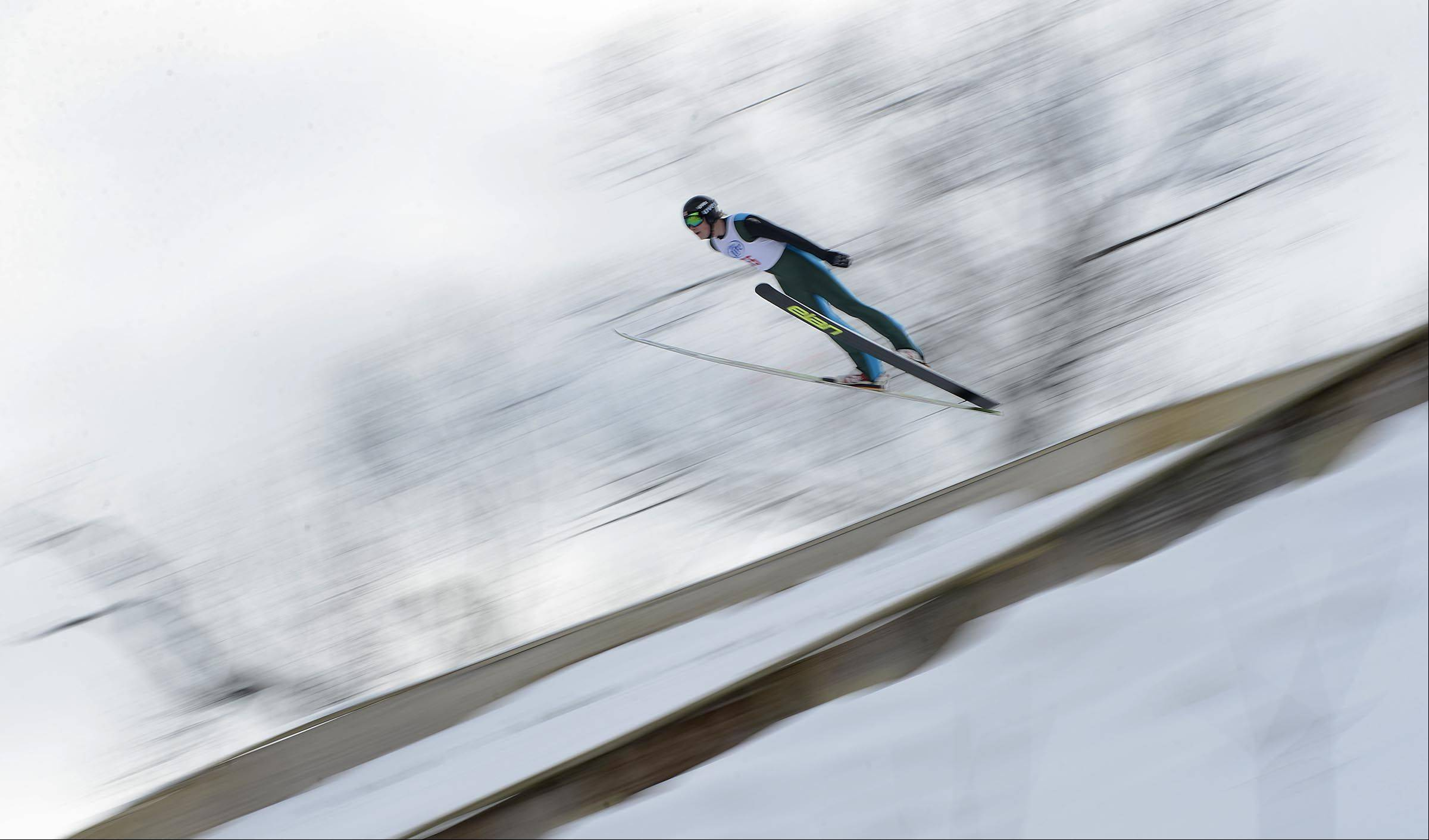 Brian Wallace, 20, of Minnesota, sails down the 70-meter competition hill Sunday at the Norge International Ski Jumping Tournament in Fox River Grove. More than 60 skiers competed in Sunday's event.