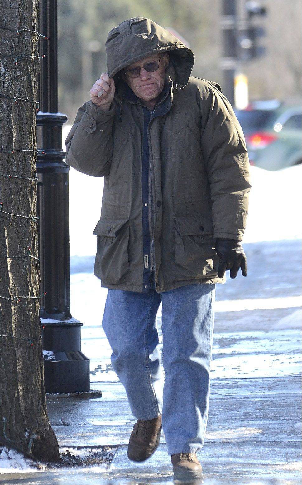 Bob Pinion, of Rolling Meadows, braves the cold while walking in downtown Palatine Thursday.