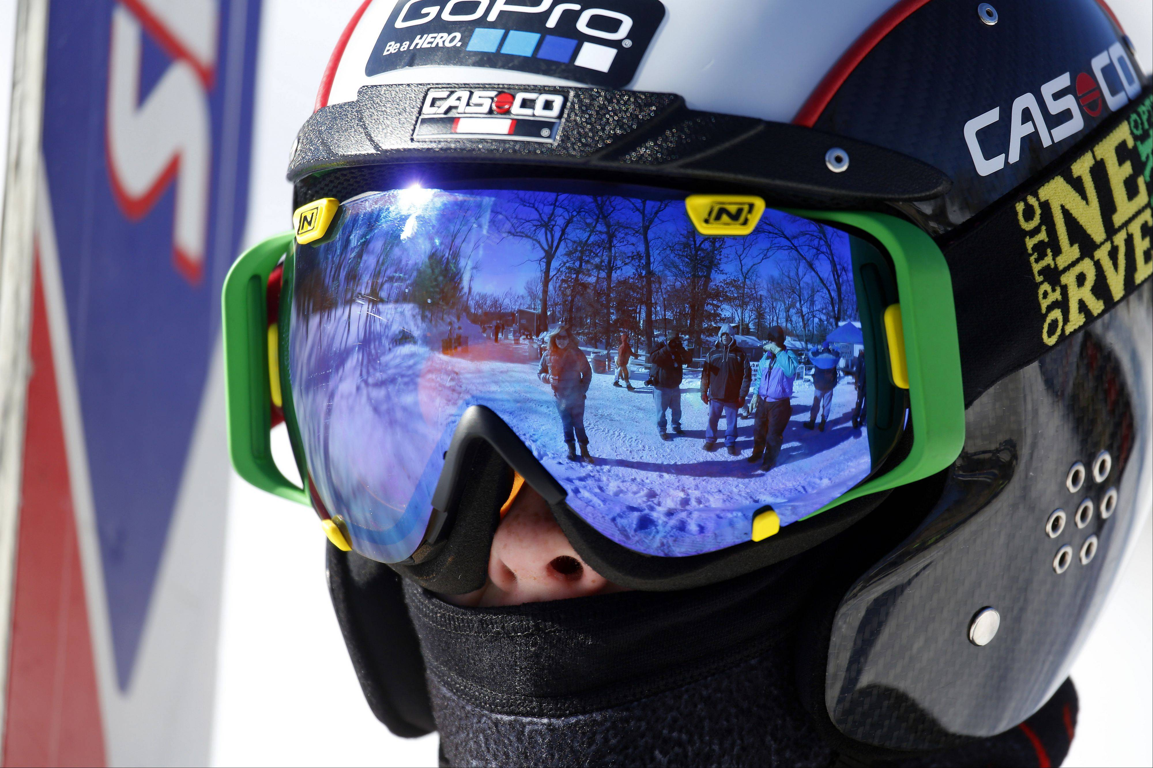All bundled up for some practice jumps, 10-year-old Matt Smith, of Cary, prepares for the next run during the 109th Norge Ski Jump Tournament Saturday in Fox River Grove.
