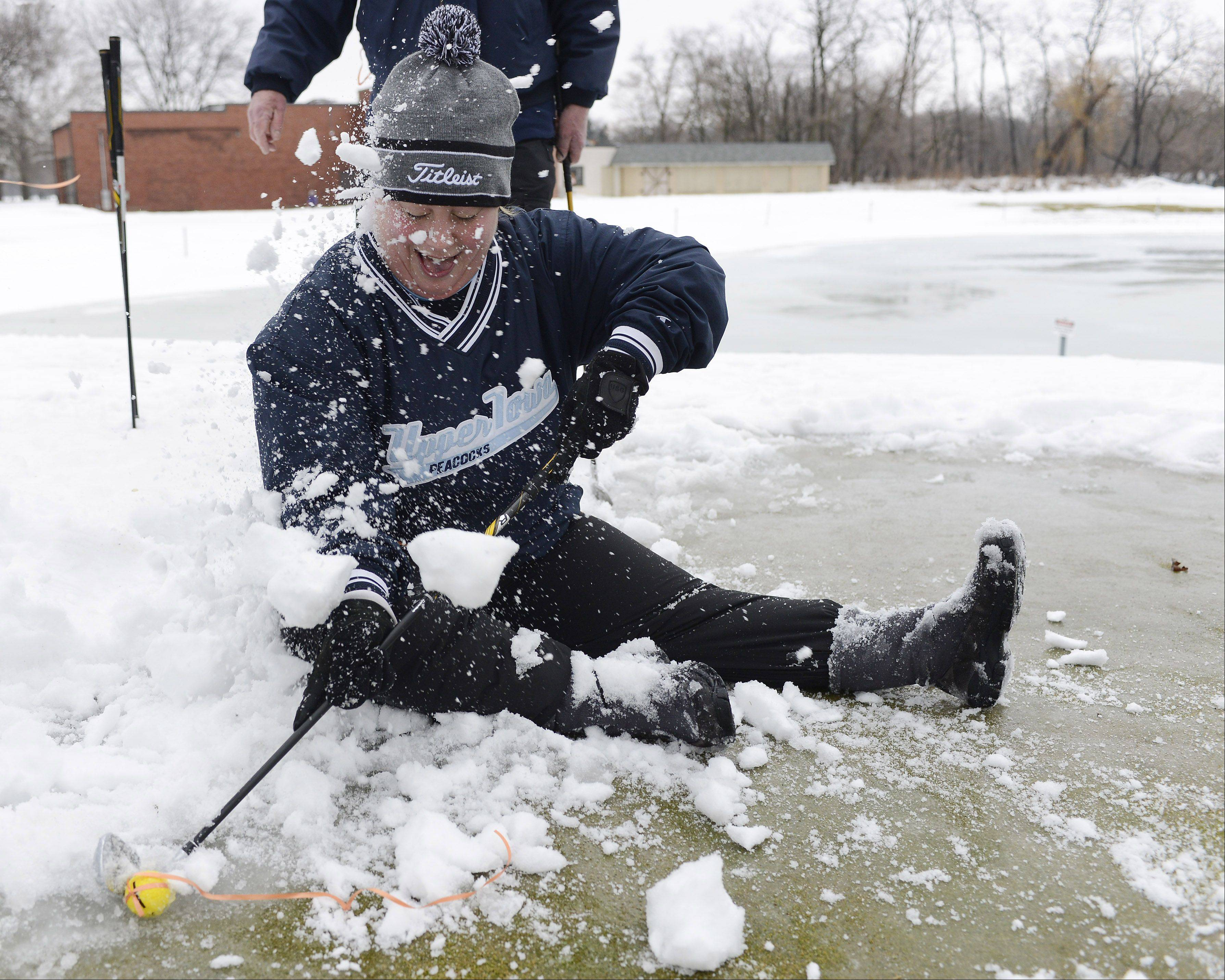 There are often times when a photographer has to make a choice between similar photos during the editing process. While covering the Chili Open at the Golf Center in Des Plaines recently, I photographed Jessica Lang of Mount Prospect just as she had slipped on an icy green while attempting a putt. The frame turned in for the next day's paper showed Lang smiling as, undeterred by her circumstances, she lined up the putt and shot anyway. After missing that attempt however, her teammates razzed her by kicking snow onto her as she gave it another try. This photo was published in the Perspective column in the print edition.