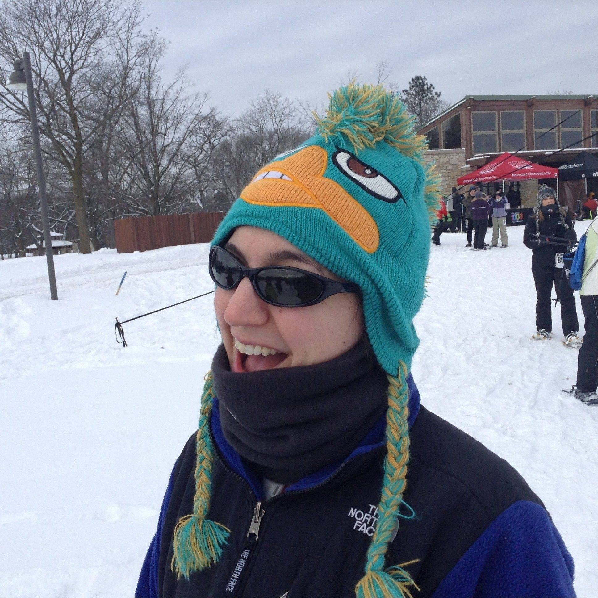 Casey Kozlowski wore a colorful Perry the Platypus hat to keep her head warm during Sunday's Frozen Zucchini Snowshoe Adventure in Barrington. The event is a fundraiser for Smart Farm, a local organization that promotes sustainable gardening and donates produce to food pantries.
