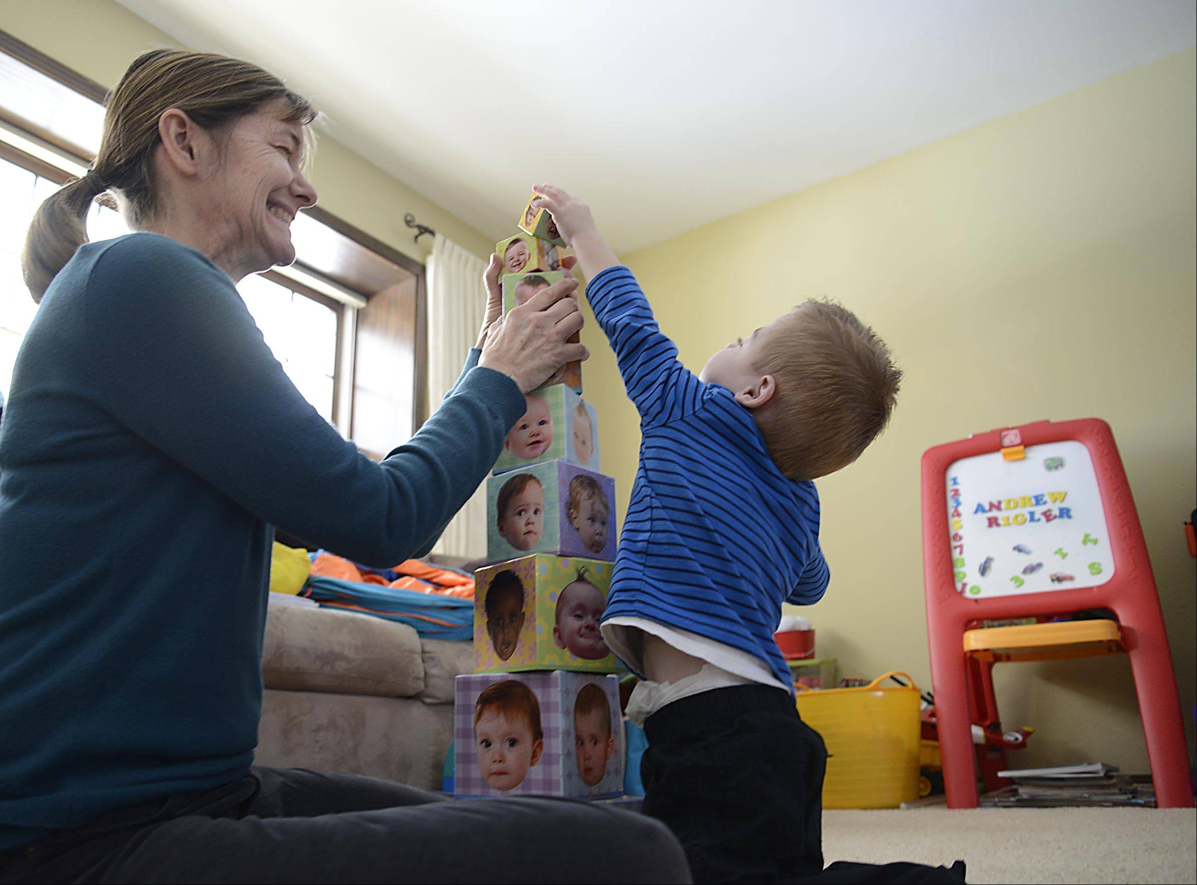 "Andrew Rigler stacks cubes with his therapist Mary Kochanski. ""There's nothing stopping him,"" his dad Larry Rigler said."