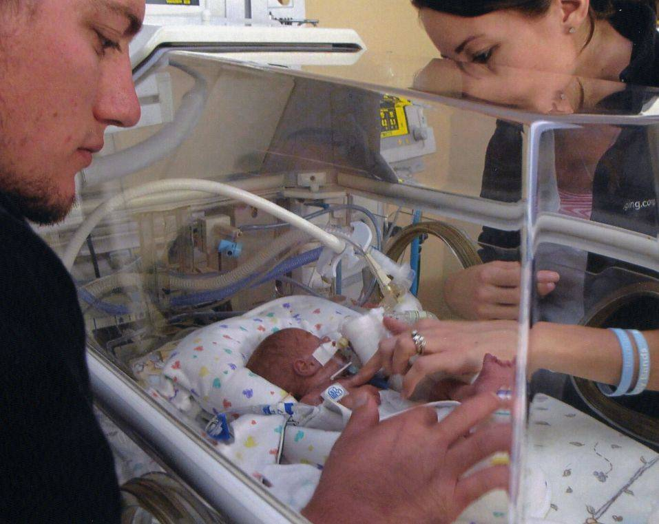 "Andrew Rigler was born weighing just more than a pound. ""This is our purpose on earth, taking care of that boy,"" his dad Larry Rigler, left, said."