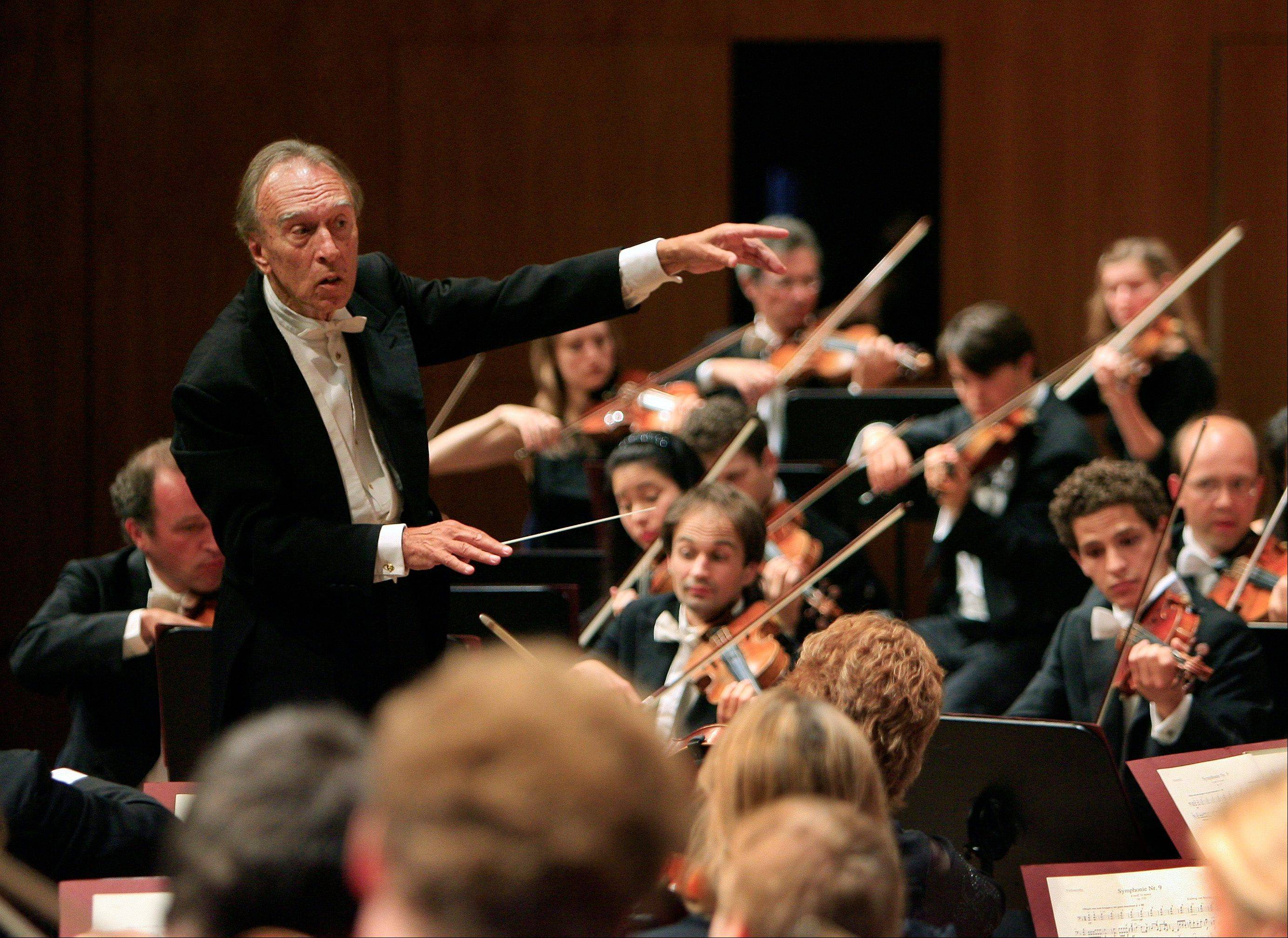 Claudio Abbado, left, conducts his orchestra during the opening concert of the Lucerne Festival in Lucerne, Switzerland. Among his many stints were as musical director of the Vienna State Opera, the Berlin Philharmonic and the London Symphony Orchestra and chief guest conductor of the Chicago Philharmonic.