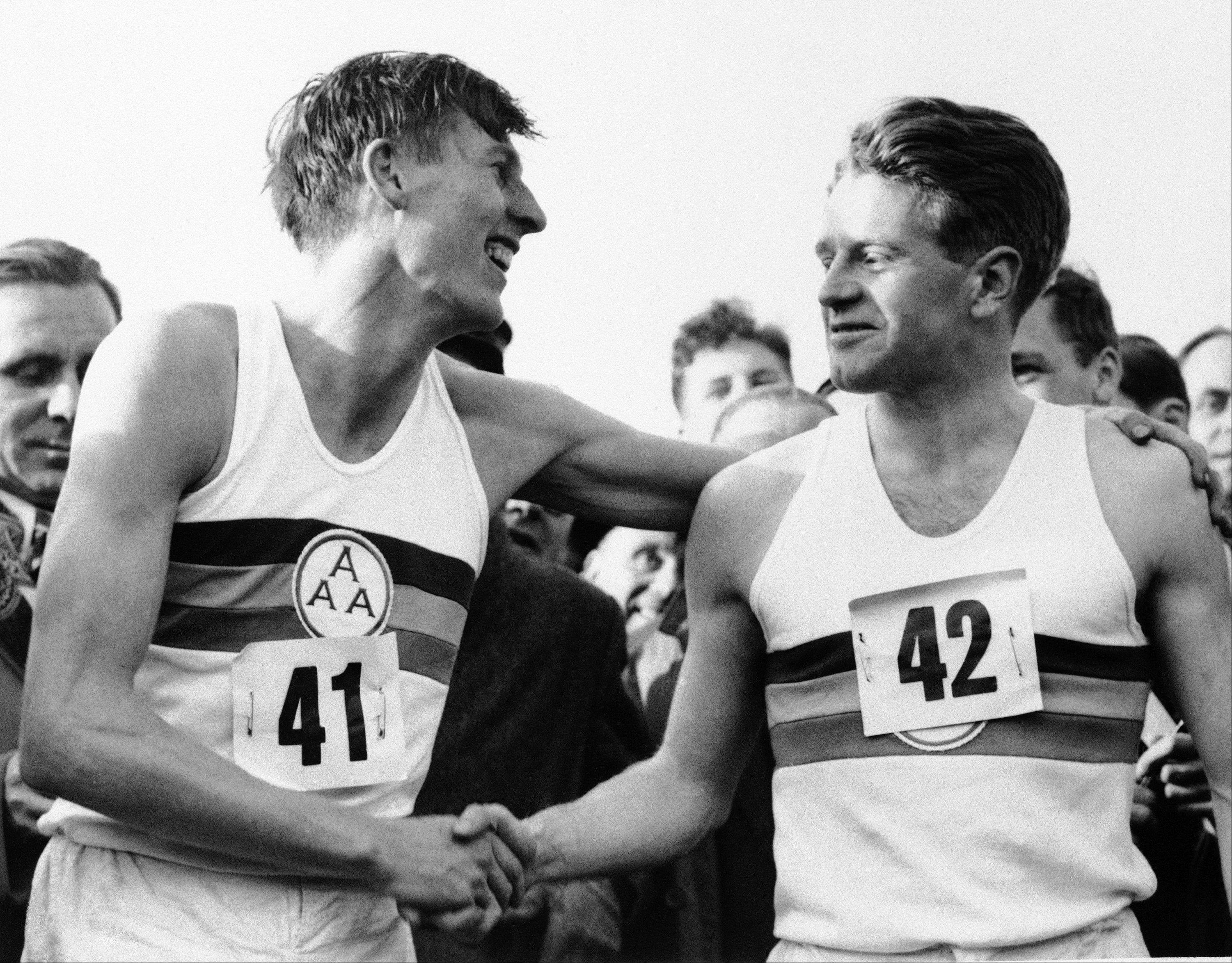 Roger Bannister, left, who ended the quest for the four-minute mile, with a time of 3:59.4 at Oxford, England is congratulated by pacemaker Christopher Chataway.