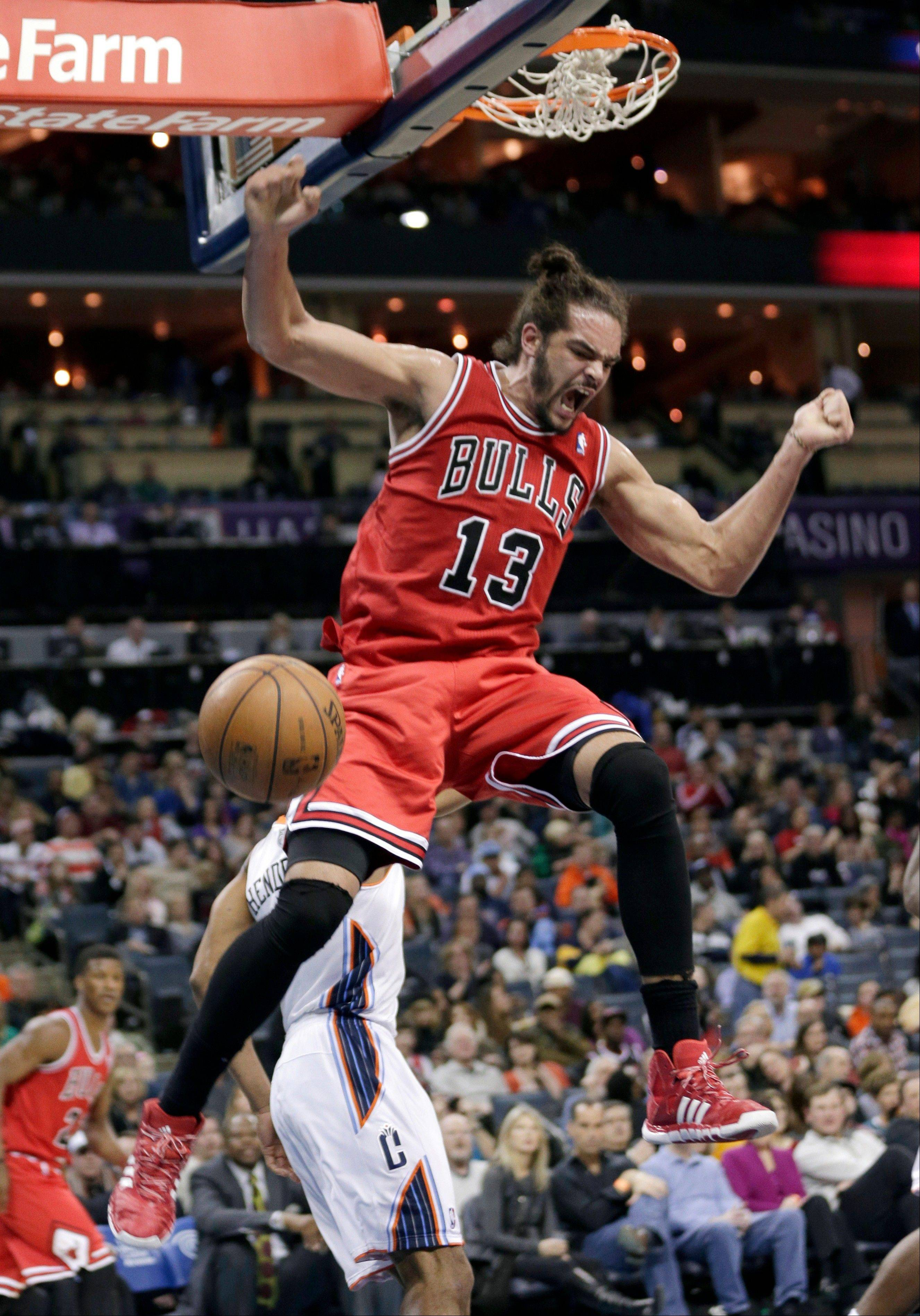 Bulls center Joakim Noah celebrates after a dunk against the Charlotte Bobcats during the second half of Saturday's game. The Bulls won 89-87.