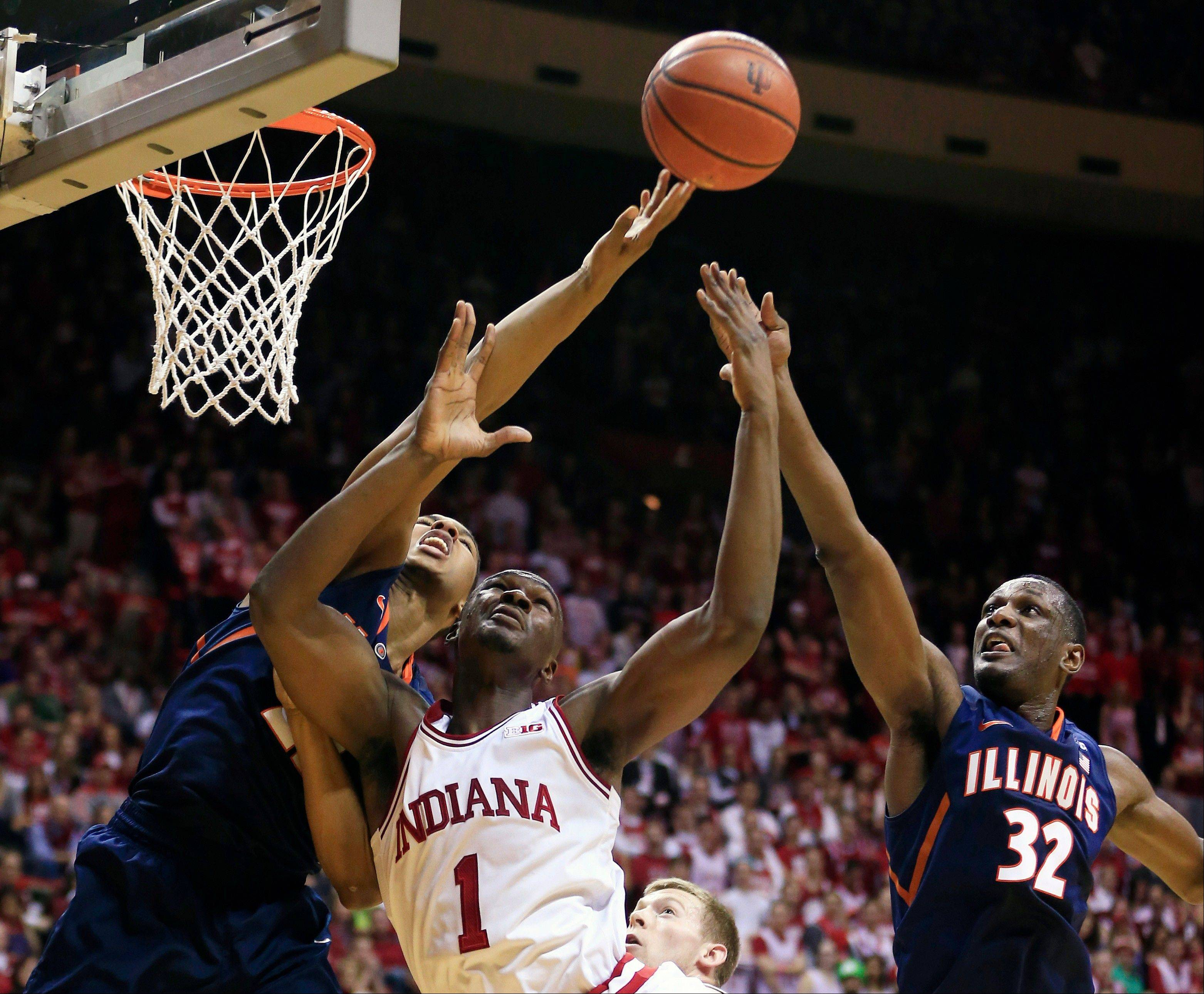 Indiana's Noah Vonleh (1) battles of a rebound against Illinois' Malcolm Hill (21) and Nnanna Egwu (32) during the first half of an NCAA college basketball game, Sunday, Jan. 26, 2014, in Bloomington, Ind.