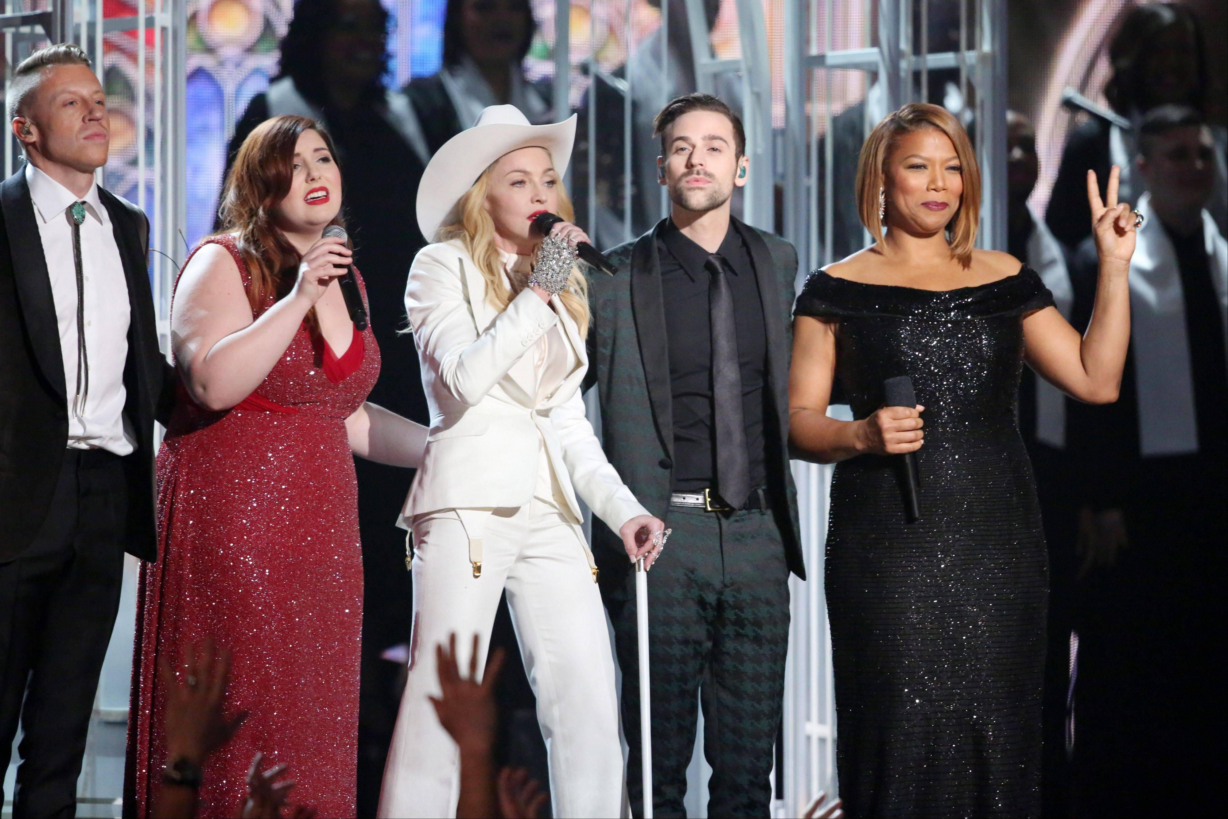 "One of the highlights of the 56th annual Grammy Awards was the performance of ""Same Love"" by Macklemore, left, Mary Lambert, Madonna, Ryan Lewis and Queen Latifah, and which also featured dozens of couples exchanging vows."