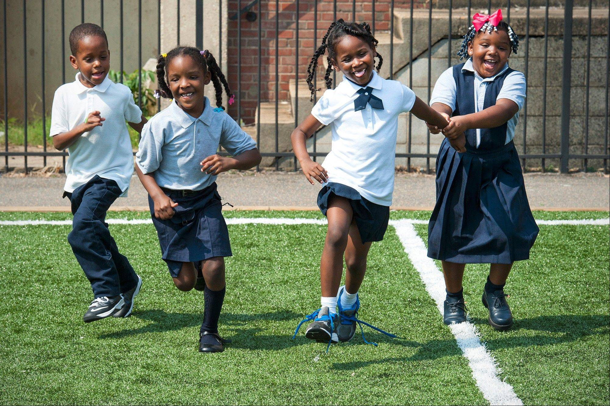"Trashon Meyer, Jamera Herndon, Moneií Brooks and Marjae Lynch run from the ""Cookie Monster"" during recess at their school in Washington."