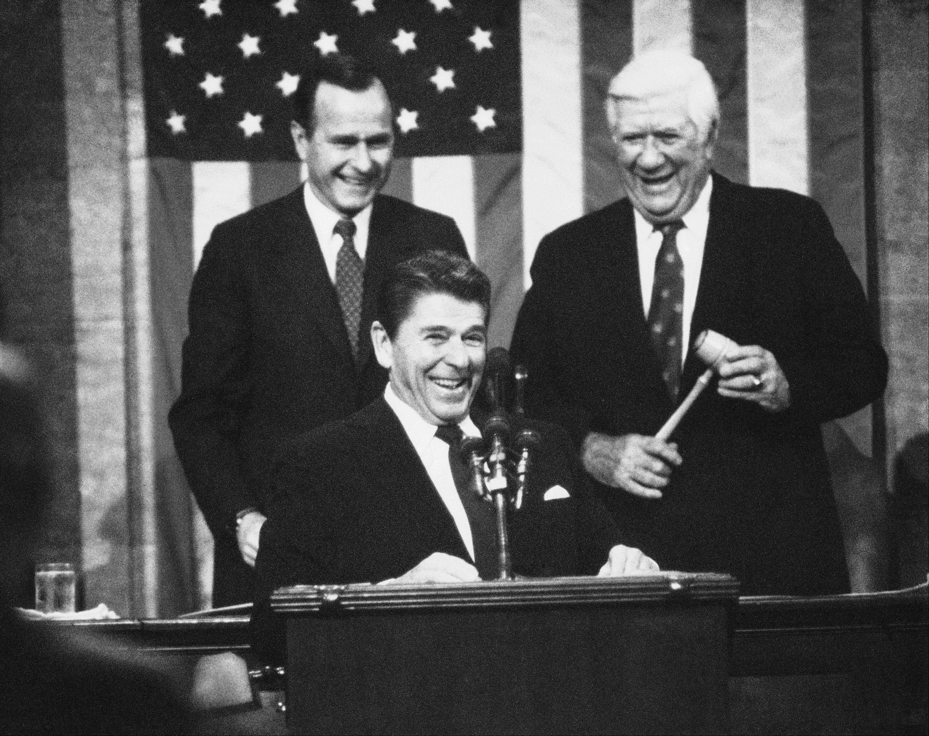 President Ronald Reagan is applauded prior to making his State of the Union Address Jan. 25, 1983. Vice President George Bush is at left, and House Speaker of the House Thomas P. O�Neill Jr. is at right.