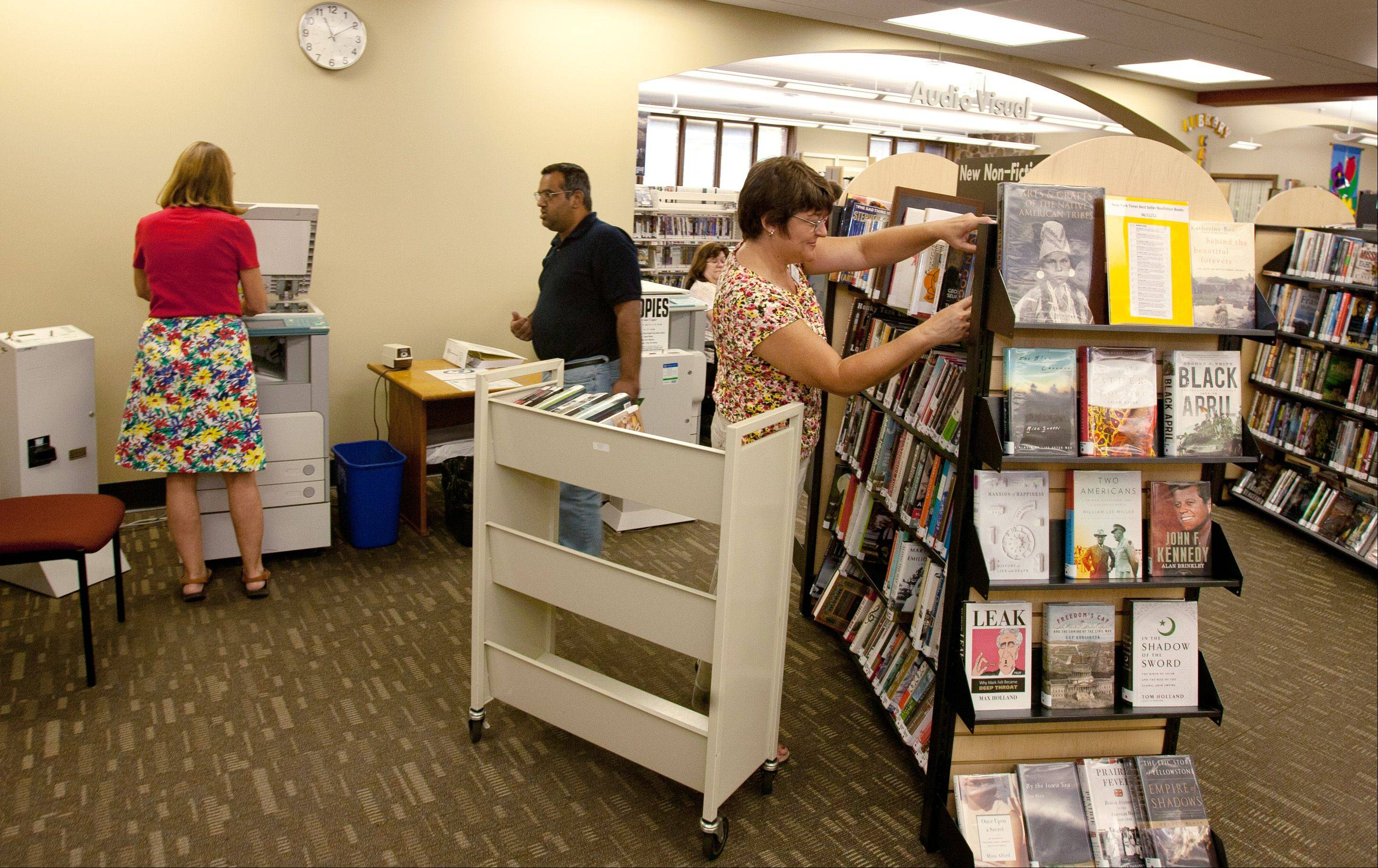 "Libraries are adapting their collections, offerings and physical space to fit patrons' needs. Lisle Library leaders say the library can be a ""third space,"" where people hang out when not at home or work. This area was converted to a ""readers' hub."""
