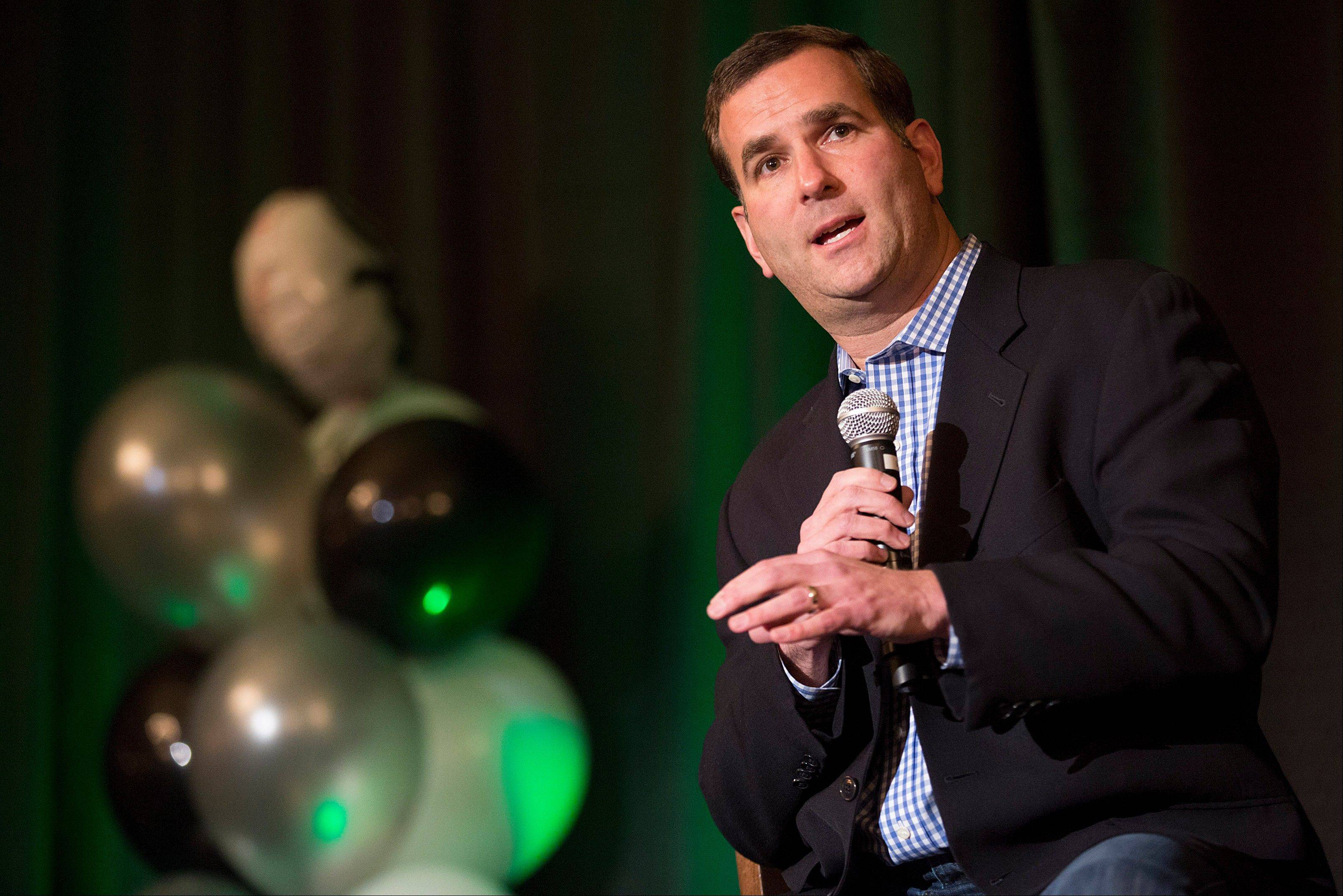 "Chicago White Sox general manager Rick Hahn speaks during the baseball team's SoxFest annual fan convention Friday in Chicago. Hahn says it's going to take some time to get some of the less experienced players ready, but ""we want to see progress."""