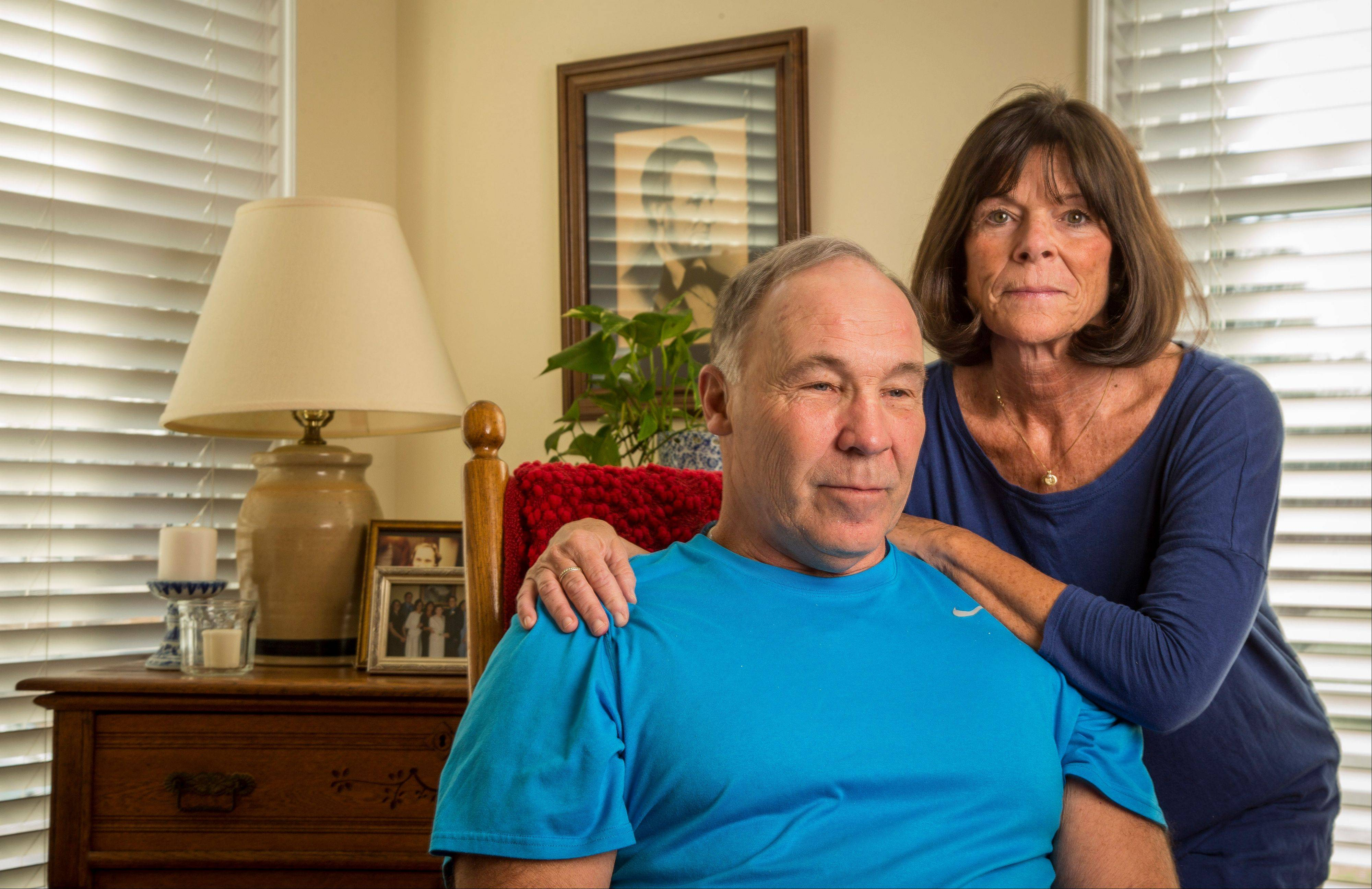 In this Jan. 23 photo, Pro Football Hall of Famer Joe DeLamielleure poses with his wife, Gerri, in their home in Charlotte, N.C. DeLamielleure is convinced that he, like many former professional football players, suffers from a concussion-related brain disease CTE brought on by the many head blows and concussions experienced during his 13 year NFL career.