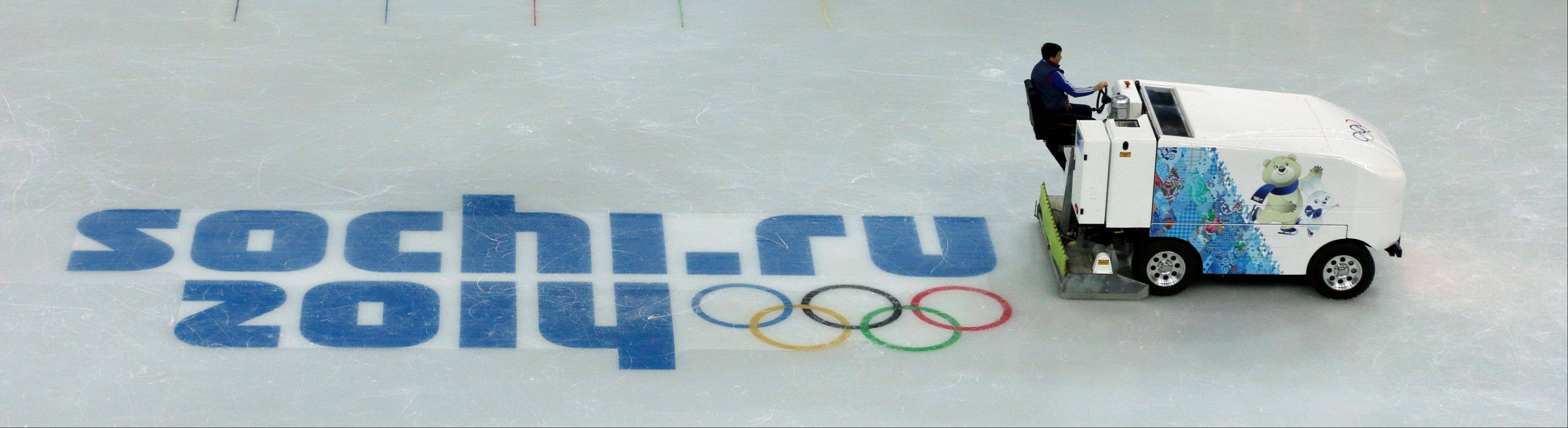 A zamboni crosses the ice at Iceberg Skating Palace at the 2014 Winter Olympics Saturday in Sochi, Russia. The Olympics begin Feb. 7.