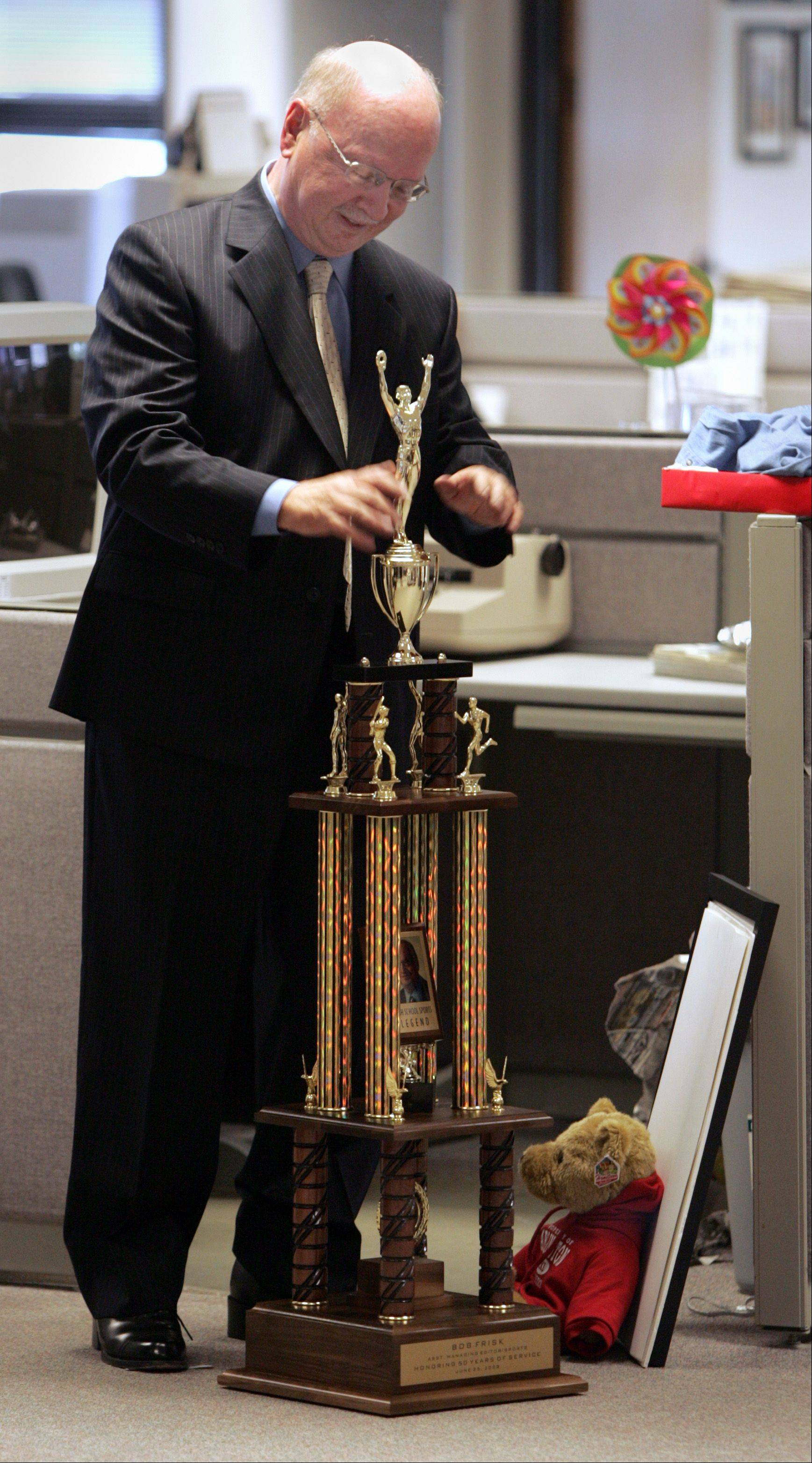 Bob Frisk, here accepting his very own Paddock Cup trophy during a ceremony to honor his 50th anniversary with the Daily Herald in 2008, will be honored again on Friday at Prospect. He�s been selected as as inaugural choice for the IHSA�s Distinguished Media Service award.
