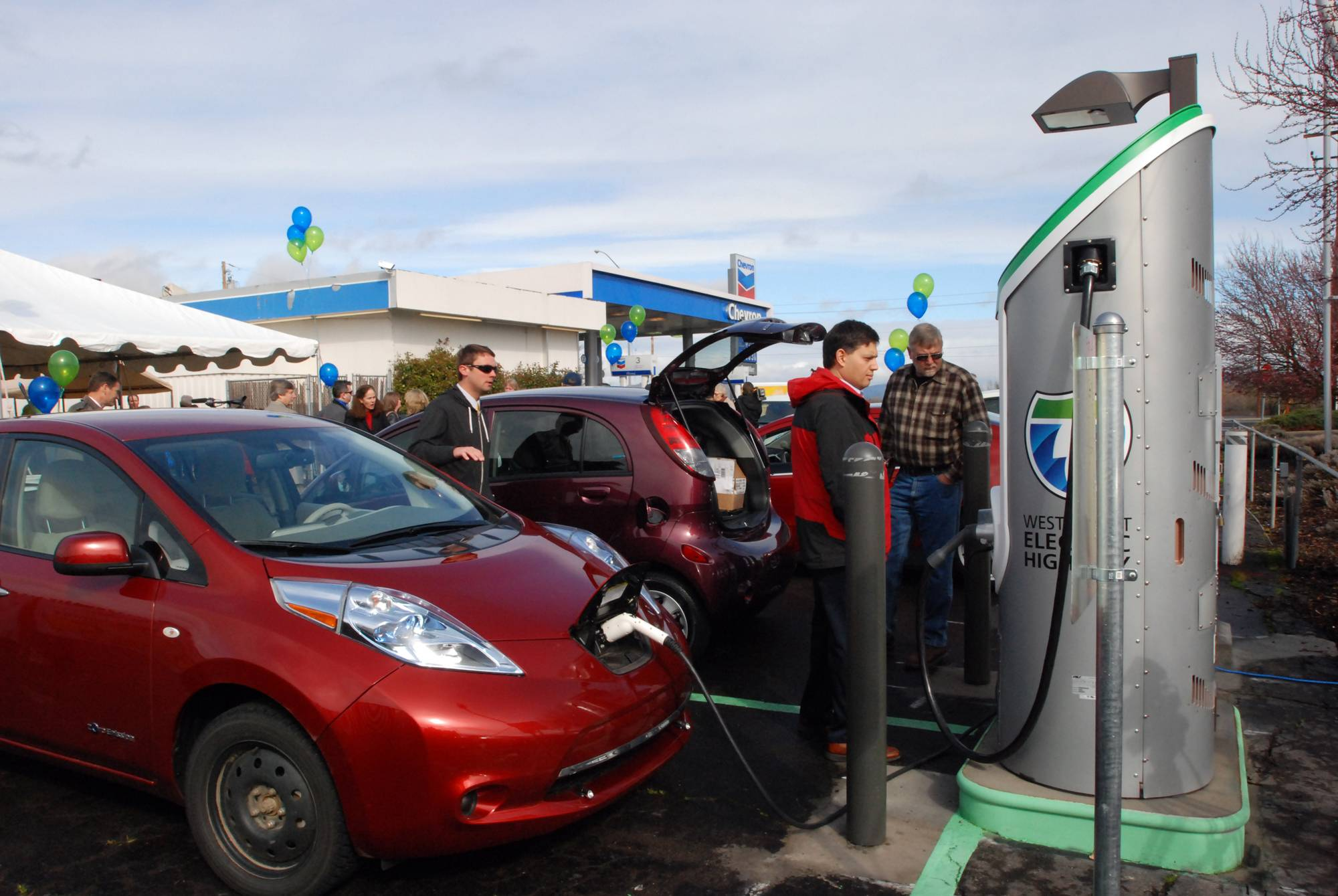 FILE - In this March 16, 2012 file photo, a Nissan Leaf tops off it's battery in Central Point, Ore., at one of the charging stations along Interstate 5. If you didn't take advantage of a wide array of tax credits and deductions last year, it looks like you'll be out of luck in 2014. Tax credits for certain electric cars though continue into 2014.
