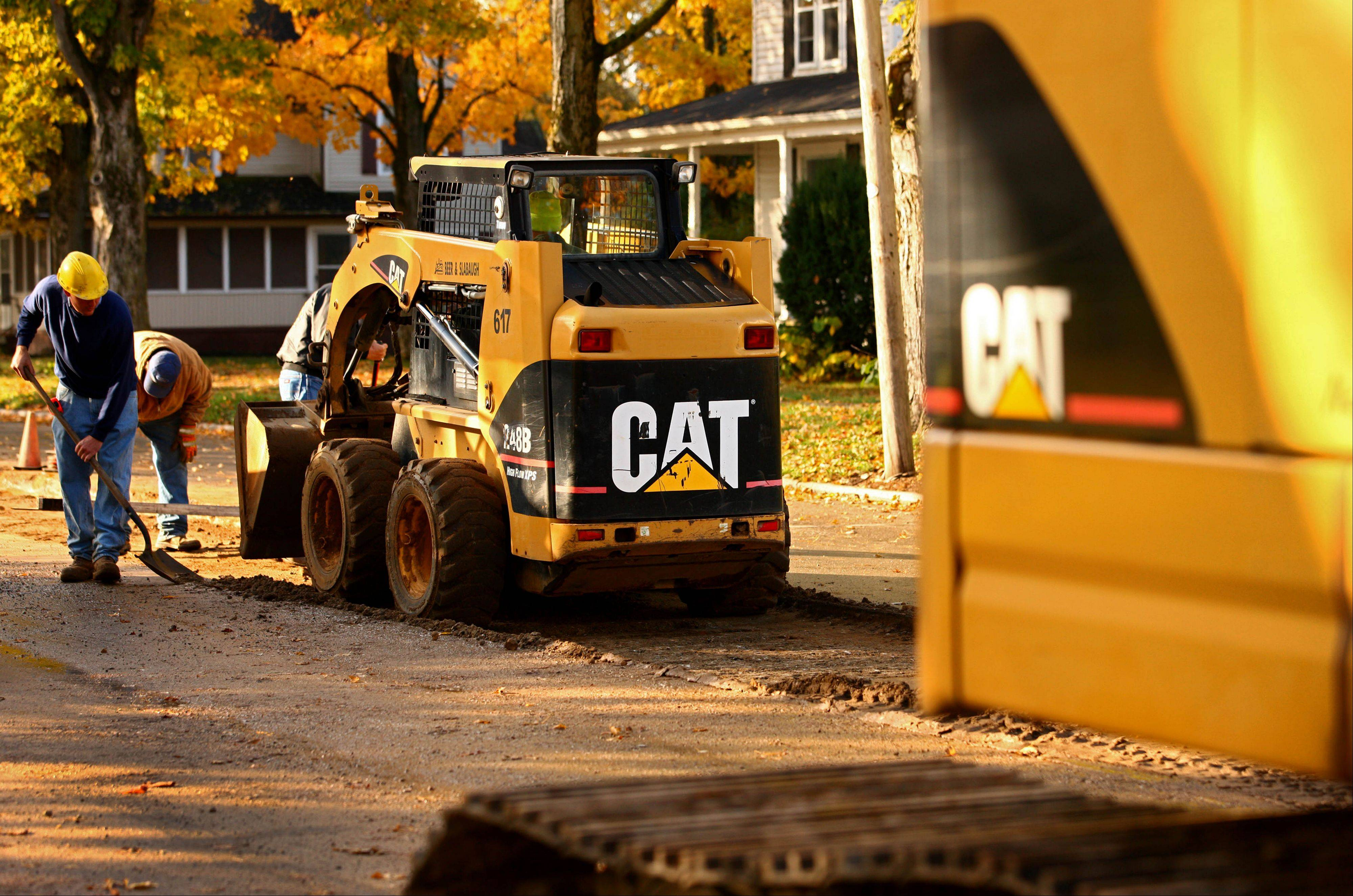 Caterpillar's fourth-quarter net income rose compared with results weighed down by a large impairment charge a year ago. Its performance topped Wall Street's view.